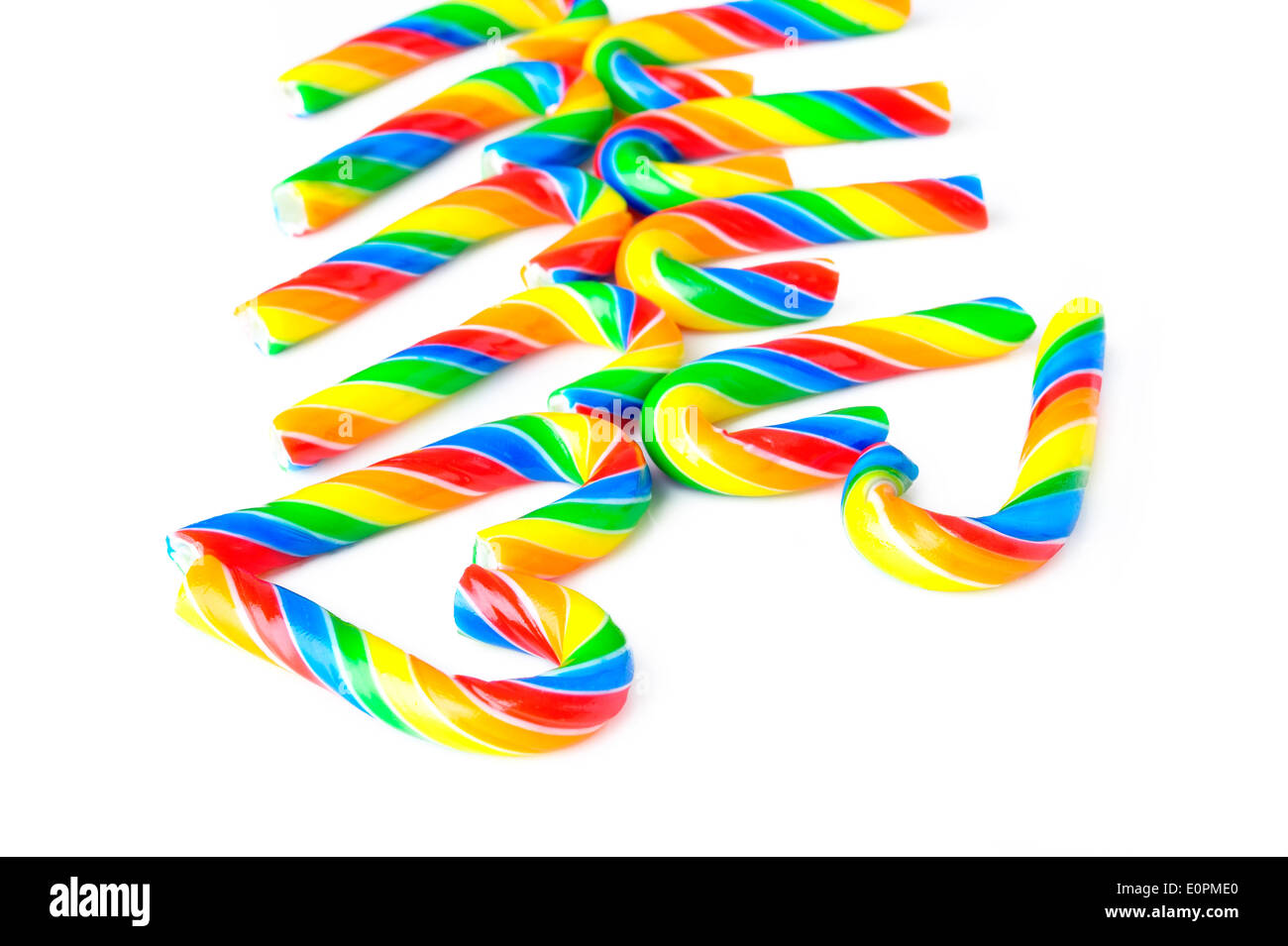 candy canes in a heart shape on a white - Stock Image