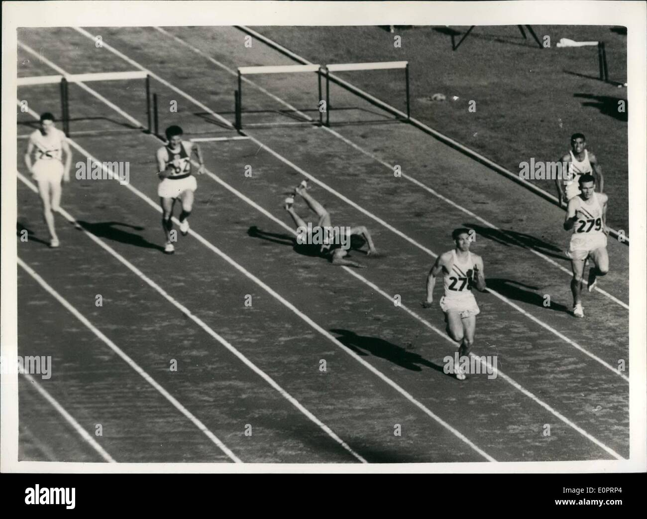 Nov. 11, 1956 - Olympic games in Melbourne. 400 metres hurdles final. Photo shows the dramatic scene as G. Potgeiter, - Stock Image