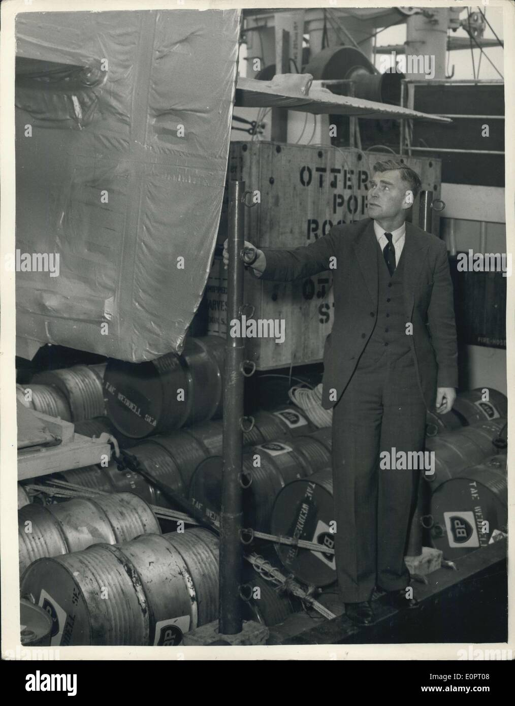 Nov. 15, 1956 - The Magga Dan leaves today for the Antarctic: The motor vessel Magga Dan sails from London today with the Commonwealth trans-Antarctic Expedition's main party for the Antarctic. Photo shows Dr. V. Fuchs, the leader of the expedition, inspects the tail unit of the Otter aircraft on board the Megga Den Butler's Wharf, Tower Bridge this morning. - Stock Image