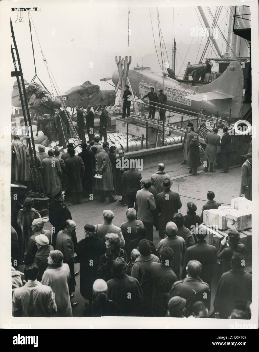 Nov. 15, 1956 - The Magga Dan Prepares to leave London for the Antarctic: The Meggs Dan, the ship that has been chartered by the London-based Trans-Antarctic Expedition to carry Dr. V.E. Fuchs, the leader, and the main party of explorers to the ''ice continent'' for their trek to the South Pole and beyond, was taking last minute supplies aboard at Butler's Wharf, Tower Bridge, before she leaves this morning. Photo shows Last minute preparation around the Magga Dan at Butler's Wharf, Tower Bridge before she left this morning. - Stock Image