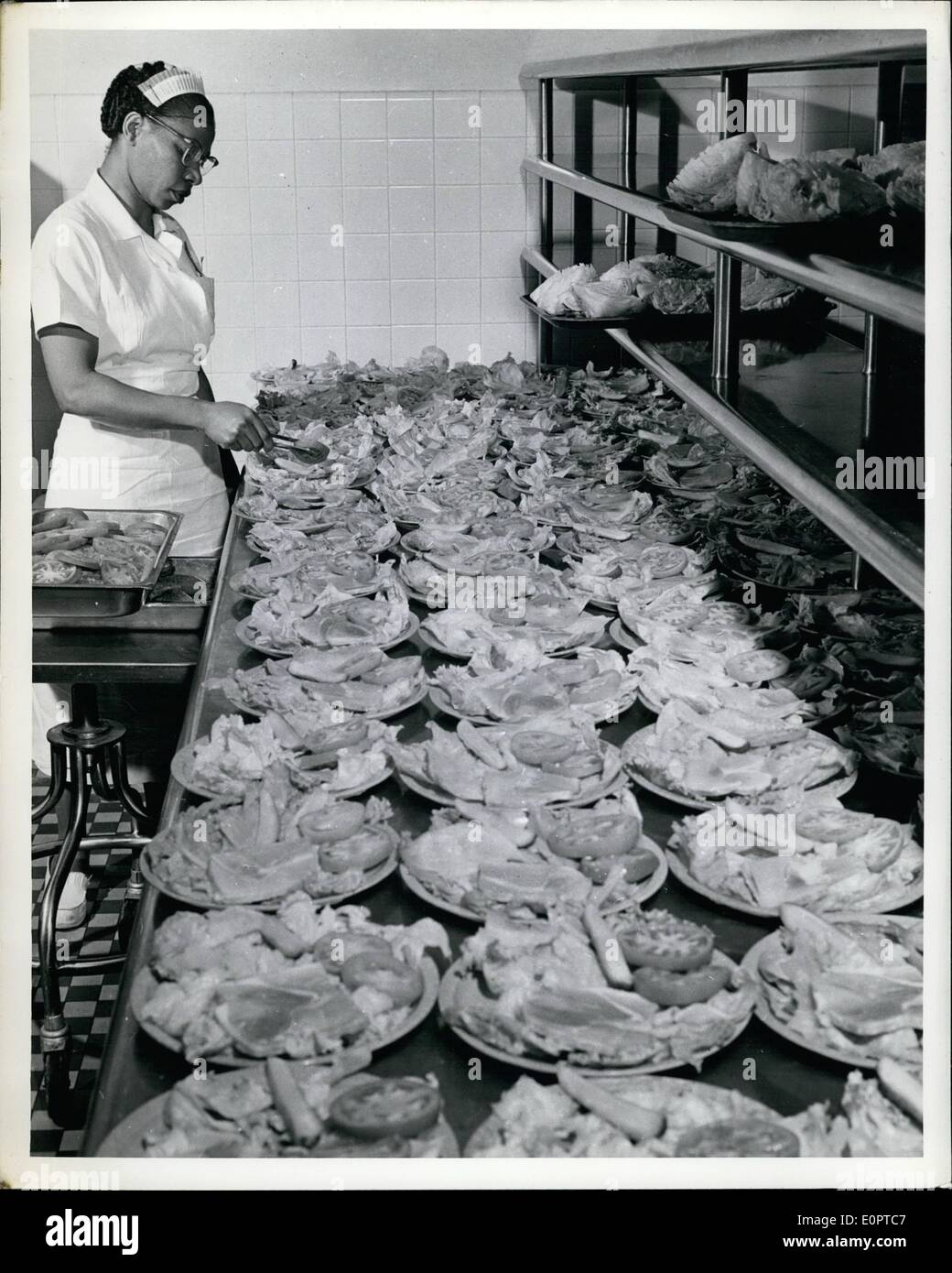 Feb. 02, 1957 - The Pentagon, nerve Center Of Defense: Approximately 675 persons are required to operate the pentagon's two restaurants, six cafeterias, nine beverage bars and outdoor snak bar. a kitchen worker is shown prepare salads for a noonday meal. - Stock Image