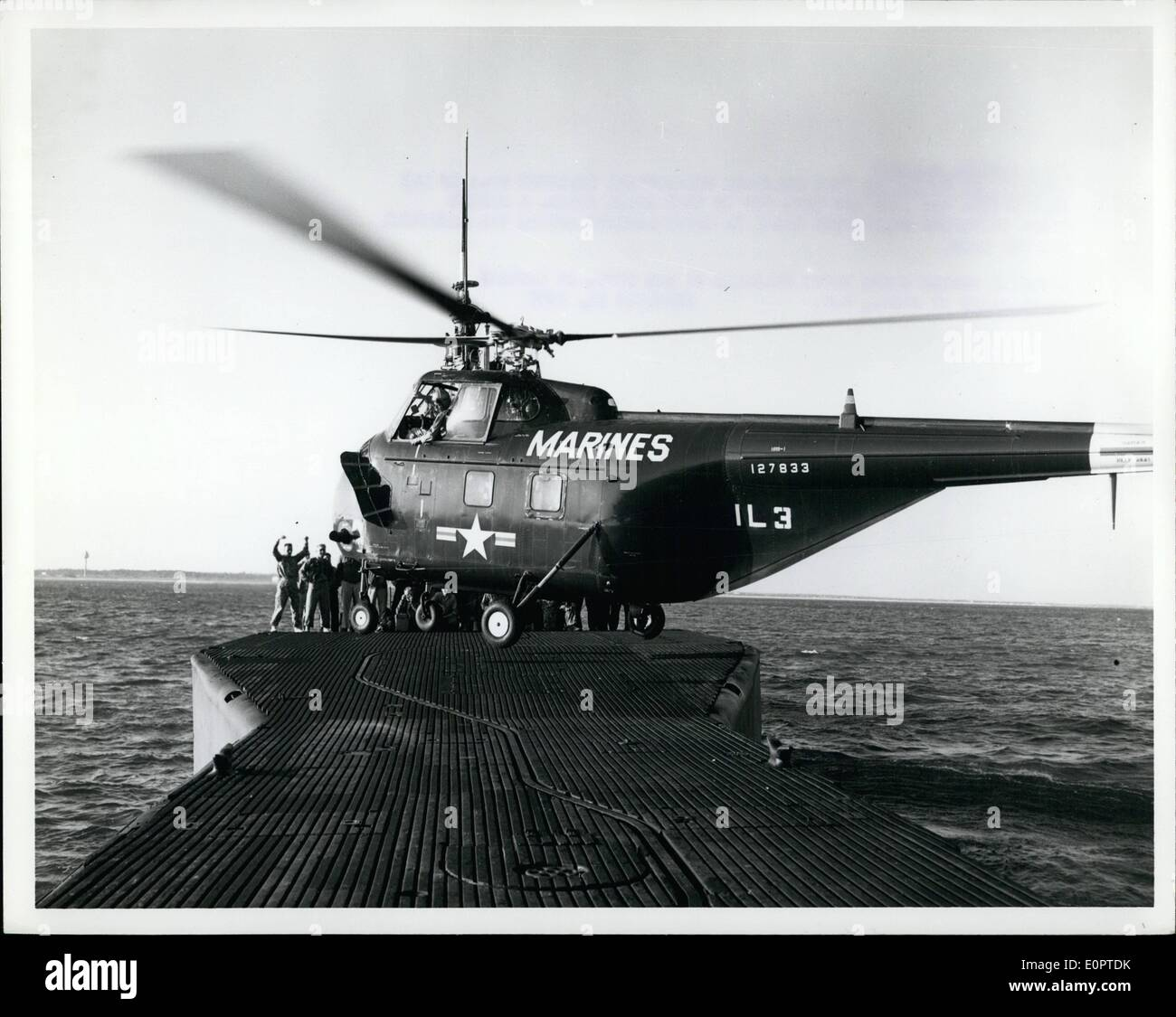 Feb. 02, 1957 - Versatility Unlimited The Military Helicopter Helicopters can land and take off in very small areas. A marine - Stock Image