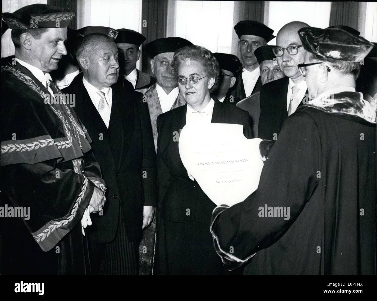 Feb. 23, 1957 - The Economic and Social Sciences faculty of Freien University in Berlin honored Mrs. Dulles today. She is a consultant on economic problems in the German division of the American State Department. Pictured: Middle - Mrs. Eleanor Dulles Left - Rector of the university Prof. Dr. Andreas Paulsen Right with certificate - Prof. Dr. Karl Thalheim, dean of Economic and Social Sciences Faculty. - Stock Image