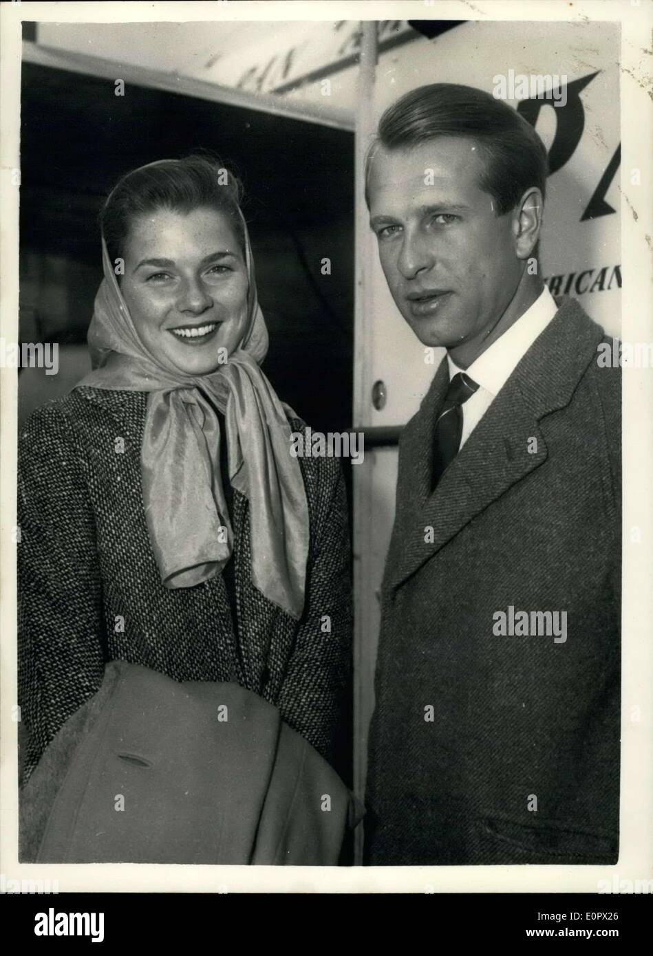 Mar. 27, 1957 - Peter Collins brings his Bride Home Racing Driver and Actress wife: Peter Collins the popular British Motor Race Driver - and his bride - actress Louise Cordier arrived at London Airport today. The couple met at the Prince Rainier - Grace Kelly wedding in Monte Carlo - and were married in Miami. Photo Shows Mr. and Mrs. Peter Collins on arrival at London Airport today. - Stock Image