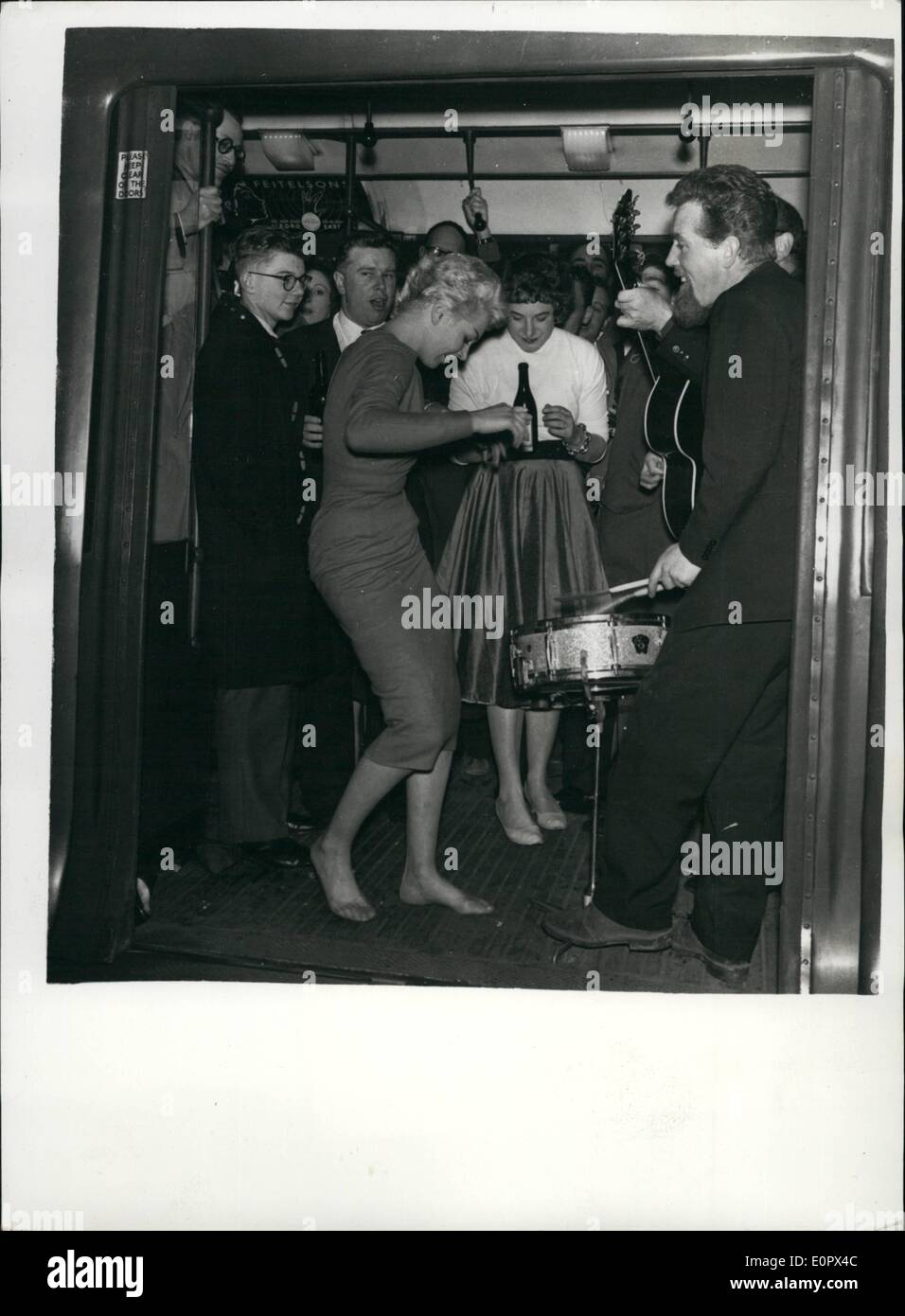 Apr. 04, 1957 - The Most fantastic party on a tube train the Hon. Gerald Lascelles goes rockin: The smart set went Underground last night and rocked non stop around the Inner Circle route from Charing Cross to Charing Cross. They skiffled and rocked their way through Euston, Kings Cross, Farringdon, and Edgware-road. And the price of the round tour was two shillings.That's what each of the 75 guests including the Queen's Cousin, the Hone. Gerald Lascelles, paid for their tickets - Stock Image