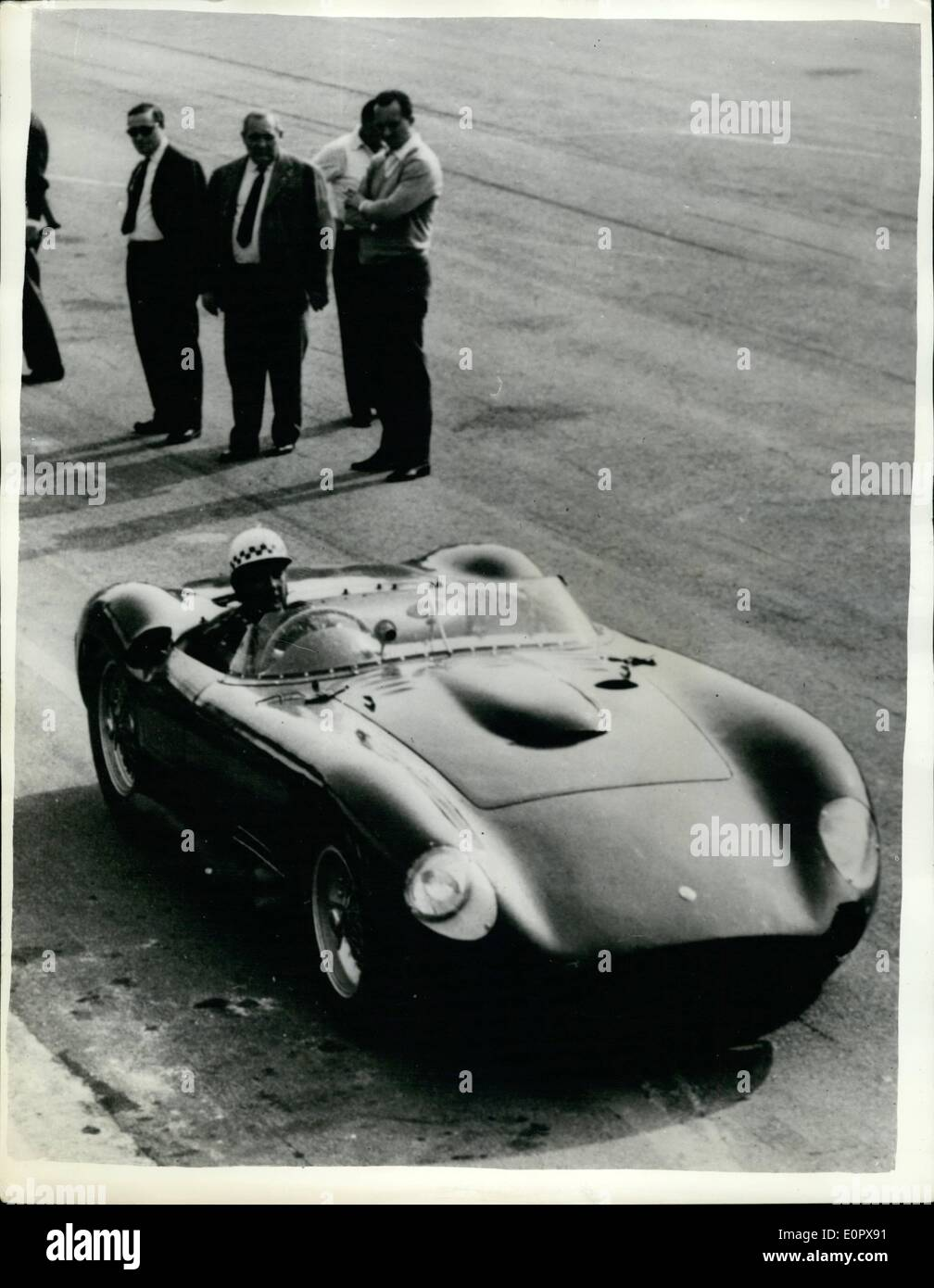 Apr. 04, 1957 - Jean Behra practises for the ''Mille Miglia'' in new Maserati.: French racing driver, jean Behra, who recenlty won the Grand Prix of Pau - seen seating off for a practise run on the Monza track, near Milan, in the new 8-cyclinder Maserati, in which he will compete in the forthcoming ''Mille Miglia'' race. - Stock Image