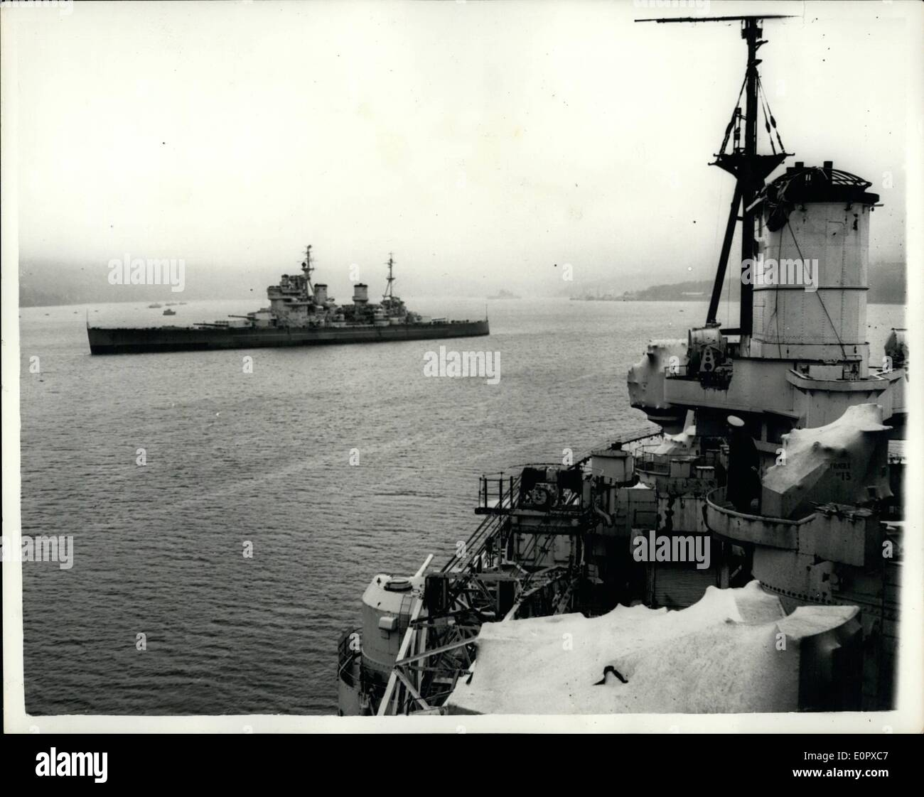 Apr. 04, 1957 - Vessels of The Royal Navy - Ready For Breakers' Yard.. Biggest Chance Ever In Military Policy. Many big ships of the Royal Navy - including H.M.S. King George V and her sister ship H.M.S. Anson - and H.M.S. Duke of York - are among the many lying at anchor at Gareloch on the Clyde - ready for the breakers' yard... They have been condemned by the Defence White Paper which signals the biggest change in Military policy ever made in normal times... Keystone Photo Shows:- Lieut. Neil Pasco who is ''In Command'' of H.M.S - Stock Image