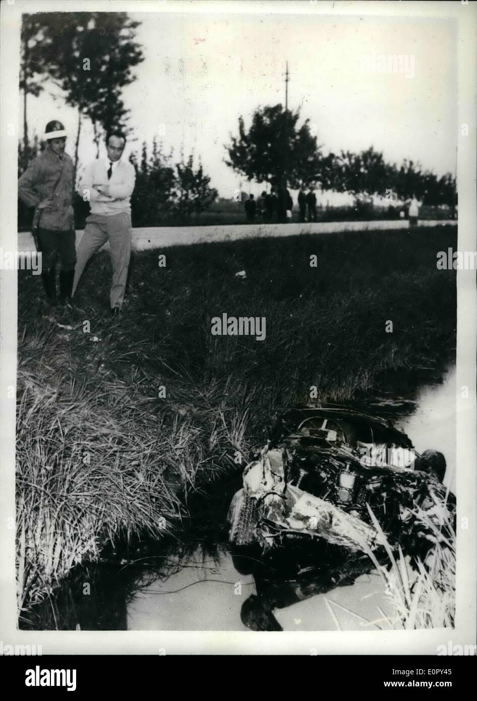 May 05, 1957 - Tragedy in the Milie Miglia Spanish Marquis crashes and fourteen die: The Spanish racing driver wealthy Marquis Alfonso de Portago and his co-driver were killed when they ferrari car crashed into the crowd after a tyre had burst near Bresoia during the Italian Mille Miglia Road Race. Twelve spectators lost their lives. Photo shows the wreckage of the car in a ditch after the tragedy near Bresia. - Stock Image