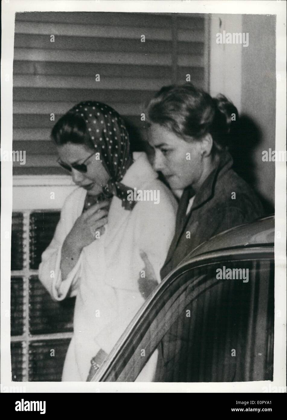 May 05, 1957 - Dram,a of the Mille Migila...Actress Linda Christian Weeps After Millionaire Finance Had Been Killed: Screen Star Linda Christian (left) weeps as she walks with a friends at the Milan-Linate airport after learning that her Wealthy friend - the Marquia Alfonso de Portago had been killed when his car crashed into the crowd near Brescia - after tyre had burst.Linda said that she and the Maerquis had intended to marry - as soon as he had obtained a divorce from his present wife. Twelve Others lost their lives as result of the Crash - Stock Image