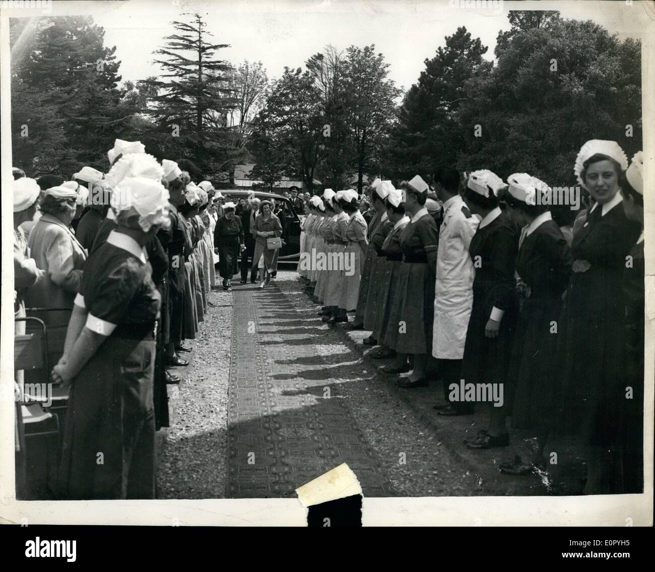 May 05, 1957 - Princess Alexandra opens new department at Royal Portsmouth Hospital: H.R.H. Princess Alexandra of Kent performed the ceremony of opening the new outpatients' department of the Royal Portsmouth Hospital. Photo shows Princess Alexandra walks between the Nurses' Guard of Honor - on arrival. - Stock Image