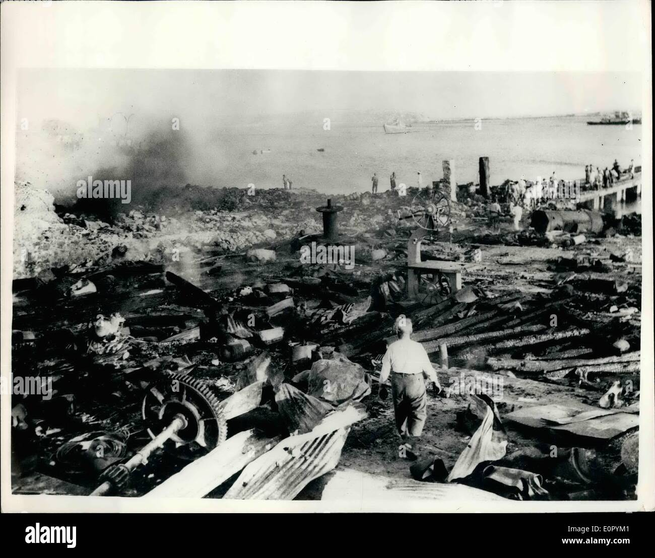 Jul. 07, 1957 - Explosives customs warehouse explodes in Pireaus. Damage estimated at one and a half million dollars.: A large area was wrecked and damage estimated at 1,500,000 U.S. Dollars was caused by a fire and explosion at the Customs Warehouse for Explosives at Perama, Pireaue, 9,000 iron bottles of gas were ruined but there were only a few minor casualties. Photo shows View of the devastated area after the explosion at Perama, Pireaus. - Stock Image