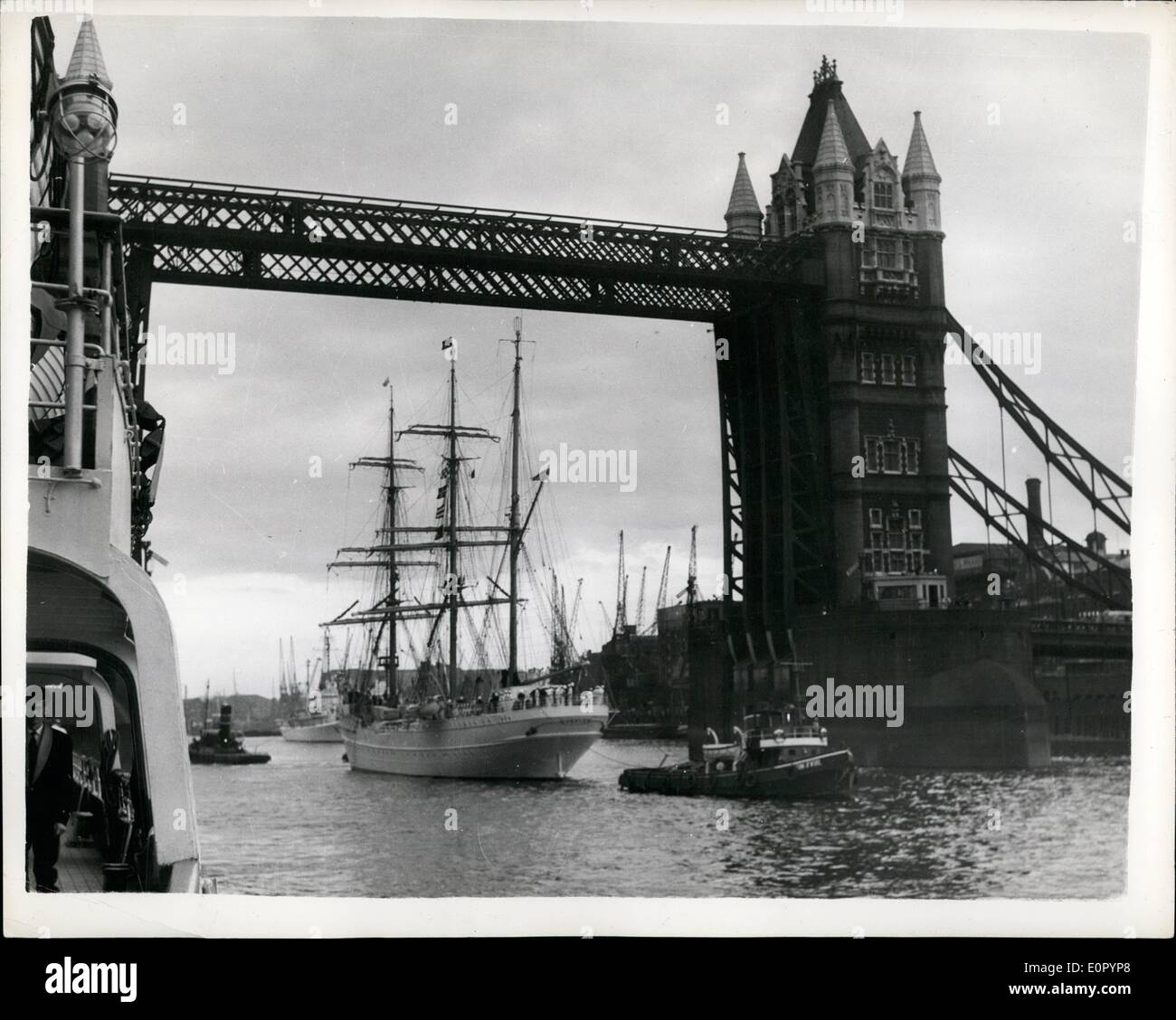 Jul. 07, 1957 - American Training Barque ''Eagle'' Arrives In The Thames: The American Coastguard Practice Squadron flagship Eagle with 350 Cadets aboard - arrived in the Thames ;last evening. They are on their annual nine weeks cruise - and the vessel is moored near Tower Bridge. The sailing ship is the Old Nazi Cadet ship ''Horst Wessei'' taken over as reparations. The 51 ft. mast of the ship had to be lowered by 14 ft. before she could pass under the top soan of Tower Bridge. Photo Shows The ''Eagle'' as she comes under the bridge - last evening. - Stock Image