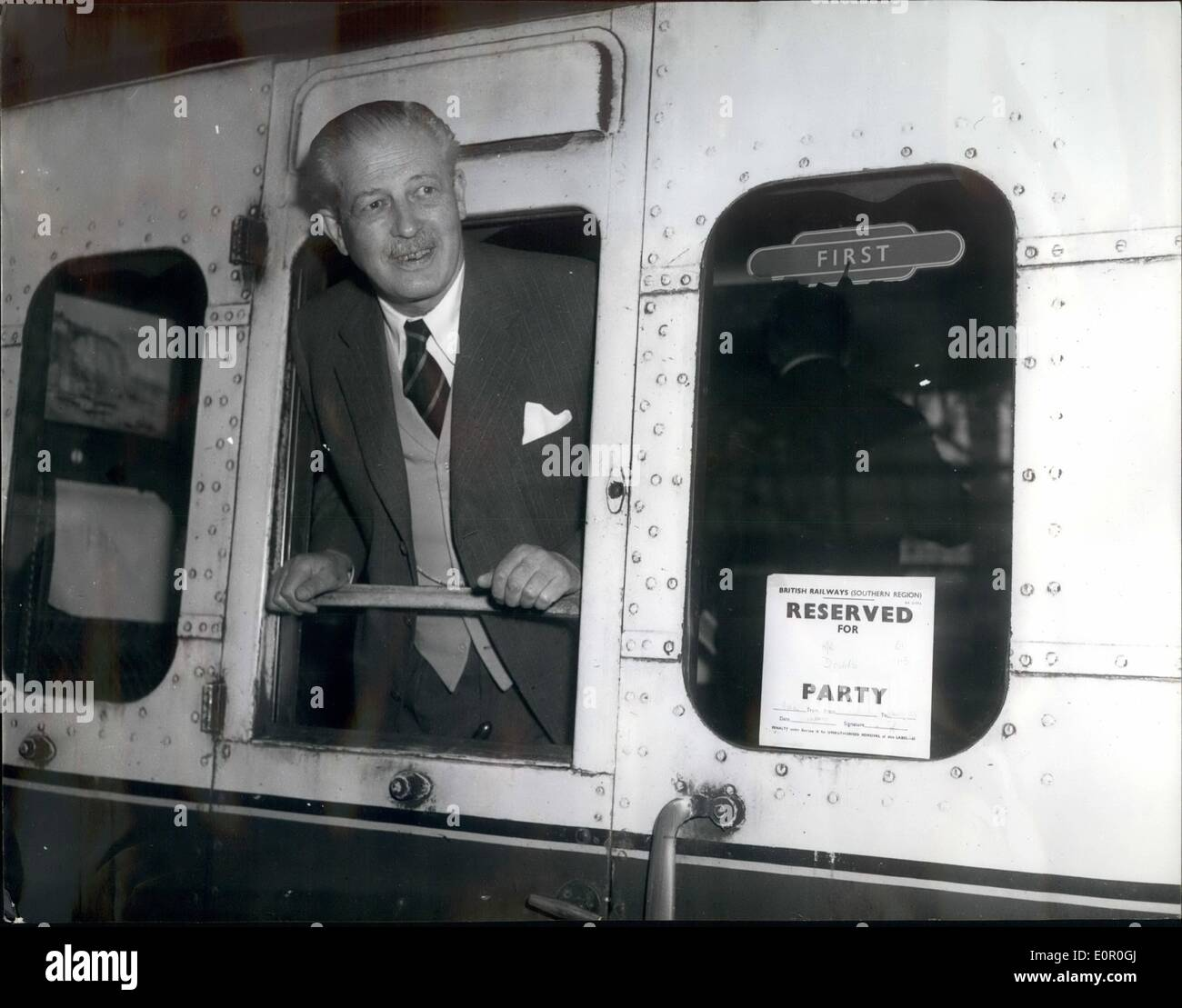 Jun. 06, 1957 - The Prime Minister Visits Sir Anthony Eden. ''Mr. Downs'' At Waterloo: Mr. Harold Macmillan the Prime Minister travelled by train to Salisbury this morning - for his visit to Sir Anthony Eden, who is resting at his country home. Photo shows Mr. Macmillan in his carriage - which is reserved for ''Mr. Downs' (Downing Street), when he left Waterloo Station for Salisbury this morning. - Stock Image