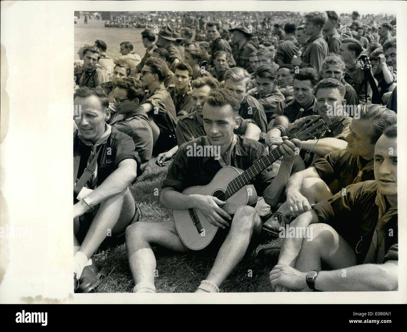 Aug. 08, 1957 - Duke of Gloucester Opens Scouting Jamboree. The World Scout Jubilee Jamboree at Sutton Coldfield, England, was opened by the Duke of Gloucester, who is President of the Boy Scouts Association. After the Duke had made his speech of welcome he drove round the ranks of 35,000 Scouts from 82 countries and toured the camps in which they are living. Picture Shows:- A group of German Scouts -- and Spanish guitars -- at Sutton Camp on opening day. - Stock Image