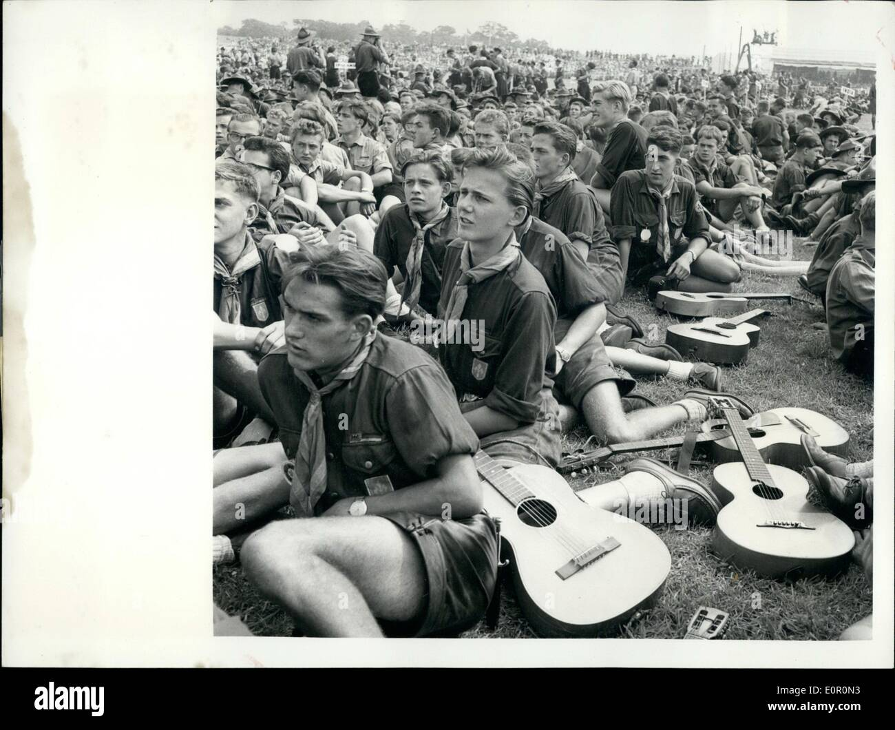 Aug. 08, 1957 - Duke Of Gloucester Opens Scouting Jamboree: The World Scout Jubilee Jamboree at Sutton Coldfield, England, was opened by the Duke of Gloucester, who is president of the Boy Scouts Association. After the Duke had made his speech of welcome he drove round the ranks of 35,000 Scouts from 82 countries and toured the camps in which they are living. Photo shows A group of German Scouts and Spanish guitars at Sutton Camp on opening day. - Stock Image