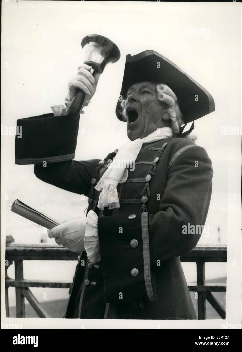 Aug. 08, 1957 - The annual town criers championship at Hastings: Twenty-two Town Criers from all parts of the country gathered at the Seaside town of Hastings ti take part in the National Town Criers Championship,Norman Wisdom, the comedian, and Vera Lynn, the well known singer, and one-time Forces Sweetheart, were judges. Photo shows Ben Johnson, the Town Crier, of Fowsy, Cornwall, who has been a town Crier since 1936, who ha won the championship four times, seen as he gets in some practice before the start of the contest today. - Stock Image