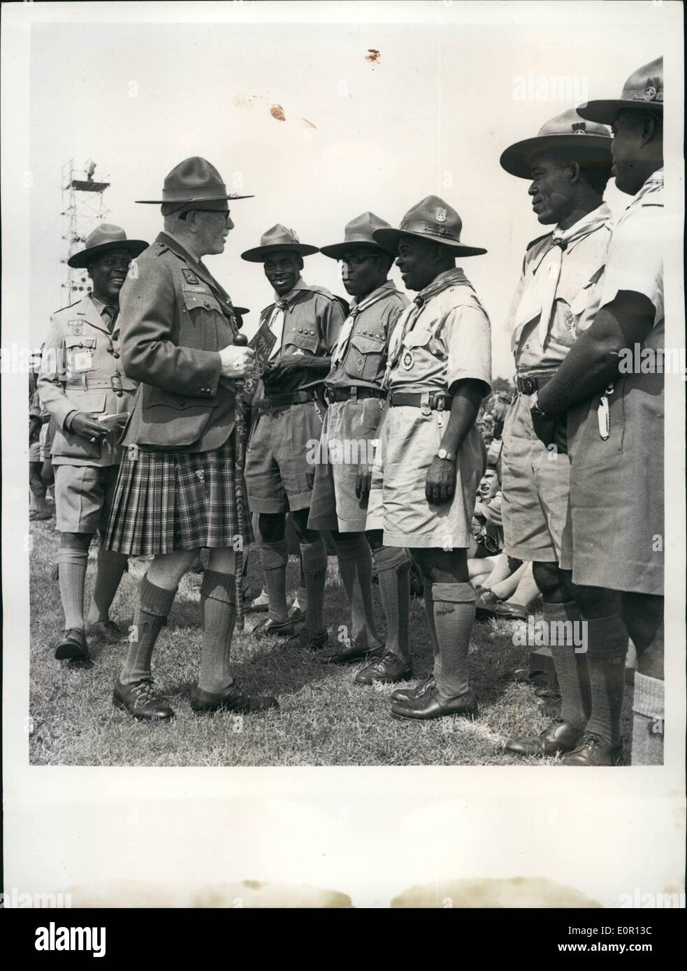 Aug. 08, 1957 - Duke of Gloucester opens Scouting Jamboree.: The World Scout Jubilee Jamboree at Sutton Cold field, England, was opened by the Duke of Gloucester, who is President of the Boy Scouts Association, After the Duke had made his speech of welcome he drove round the ranks of 35,000 Scouts from 82 countries and toured the camps in which they are living. Photo shows Major .H. Donald, second from left, former Chief Commissioner of the Gold Coast (Ghana ), chats with members of the Ghana Contingent at Sutton Camp. E.D. Tackle, head of the contingent, is on extreme left. - Stock Image