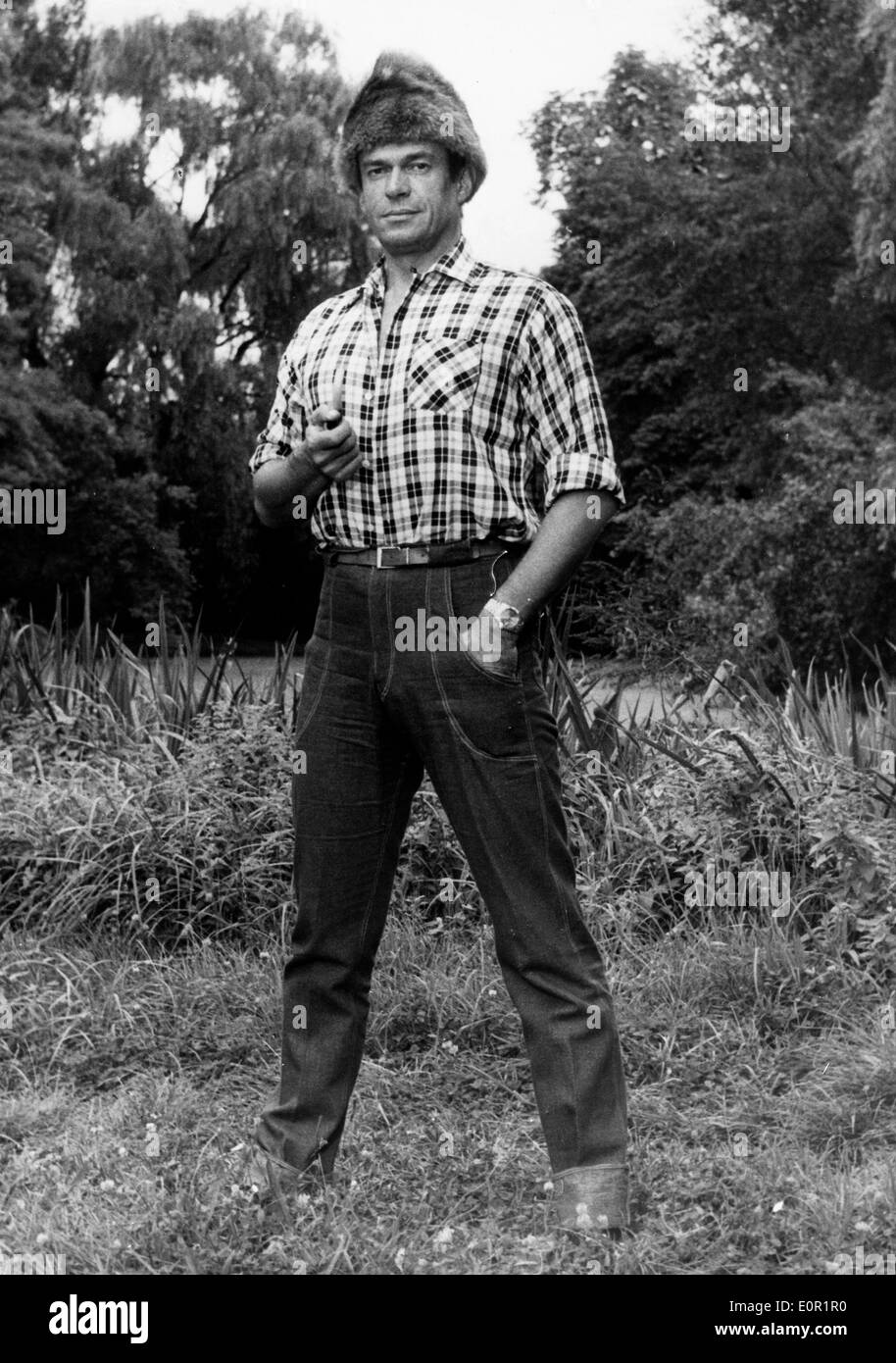 Comedian Pierre Dudan as a farmer in 'A Man Goes Back to his Past' - Stock Image