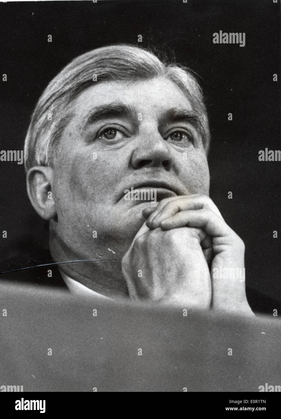 Politician Aneurin Bevan listens to speeches at a conference - Stock Image