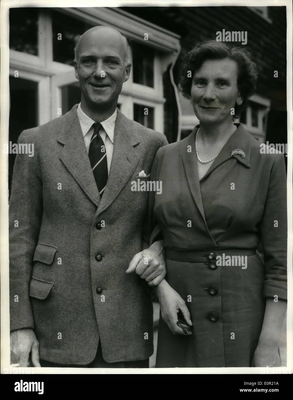 Sep. 09, 1957 - At Home with London's new Lord Mayor: Sir Denis Henry Truscott was elecdted Lord Mayor of London at Quildhall yesterday. he is the third of the family to hold the office, and succeeds Sir Cullum Welcjh. Sir Denis, who is 49, ans was married in 1932, has four daughters, and lives at Wimbledon. he is keen musician and became a member of the Musician's Company when only 18. In August 1955 he was appointed the new Master of the Vintners Company. he is head of a City printing firm founded in 1824 by his great-grand-father - Stock Image