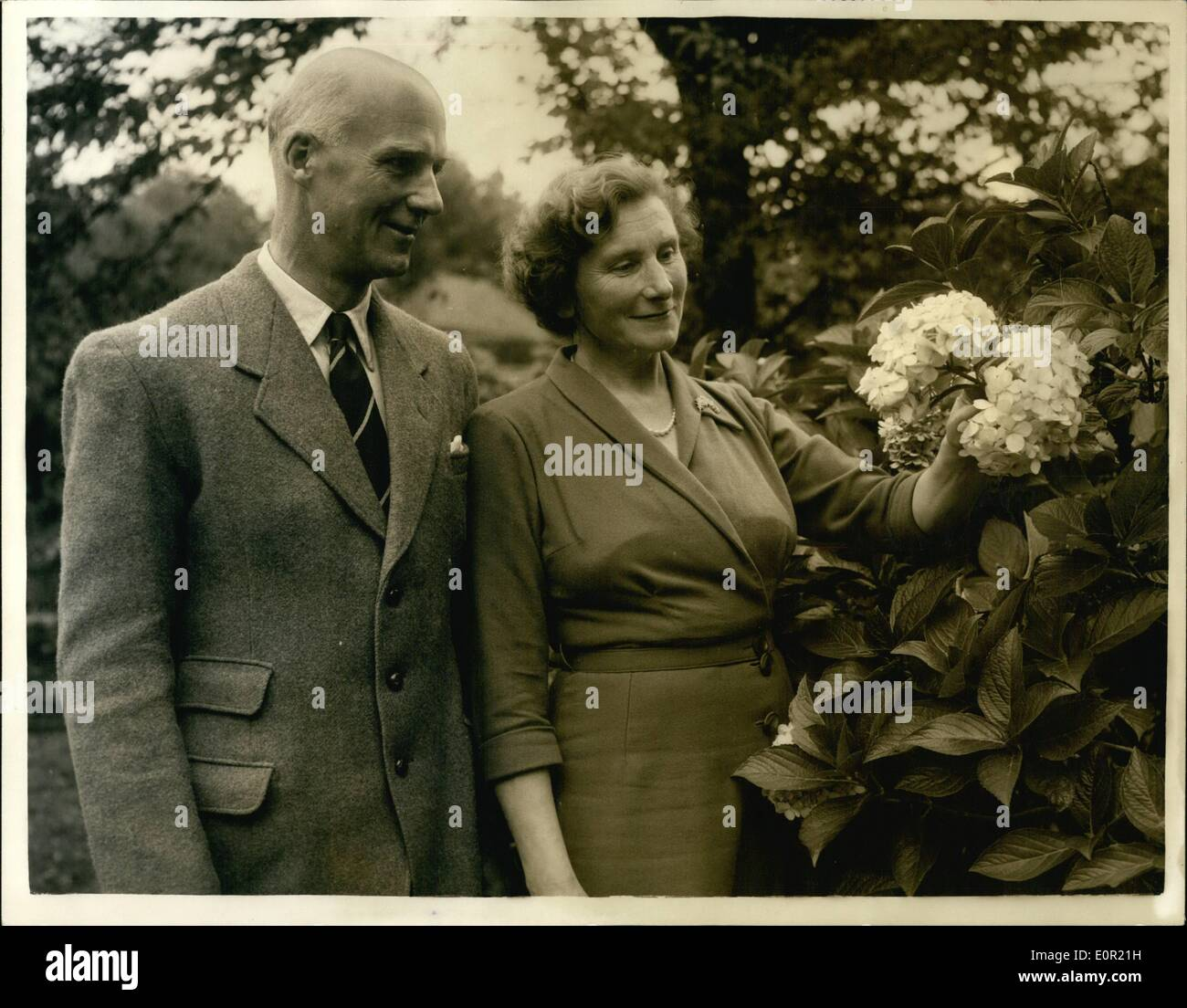 Sep. 09, 1957 - At the home with London's new Lord Mayor: Sir Denis Henry Truscott was elected Lord Mayor of London at Guildhall Saturday. He is the third member of the family to hold the office, and succeeds Sir Cullum Welch, Sir Denis, who is 49, and was married in 1932, has four daughters, and lives at Wimbledon. He is a keen musician and became a member of the Musicians' company when only 18. In August 1955 he was appointed the new Master of the Vintners Company. He is head of a City printing firm founded in 1824 by his great-grand-father - Stock Image