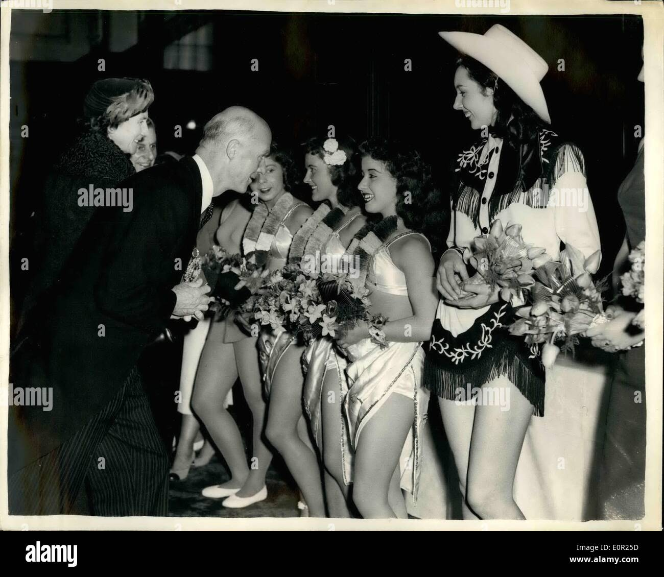 Oct. 10, 1957 - The lord mayor meets circus artistes: keystone photo shows The Lord Mayor of London, sirdenis truscott, chatting to the Elephant girls. with the cowboy whip act on right at Olympia, where the Bert man mills circus opens this afternoon. - Stock Image