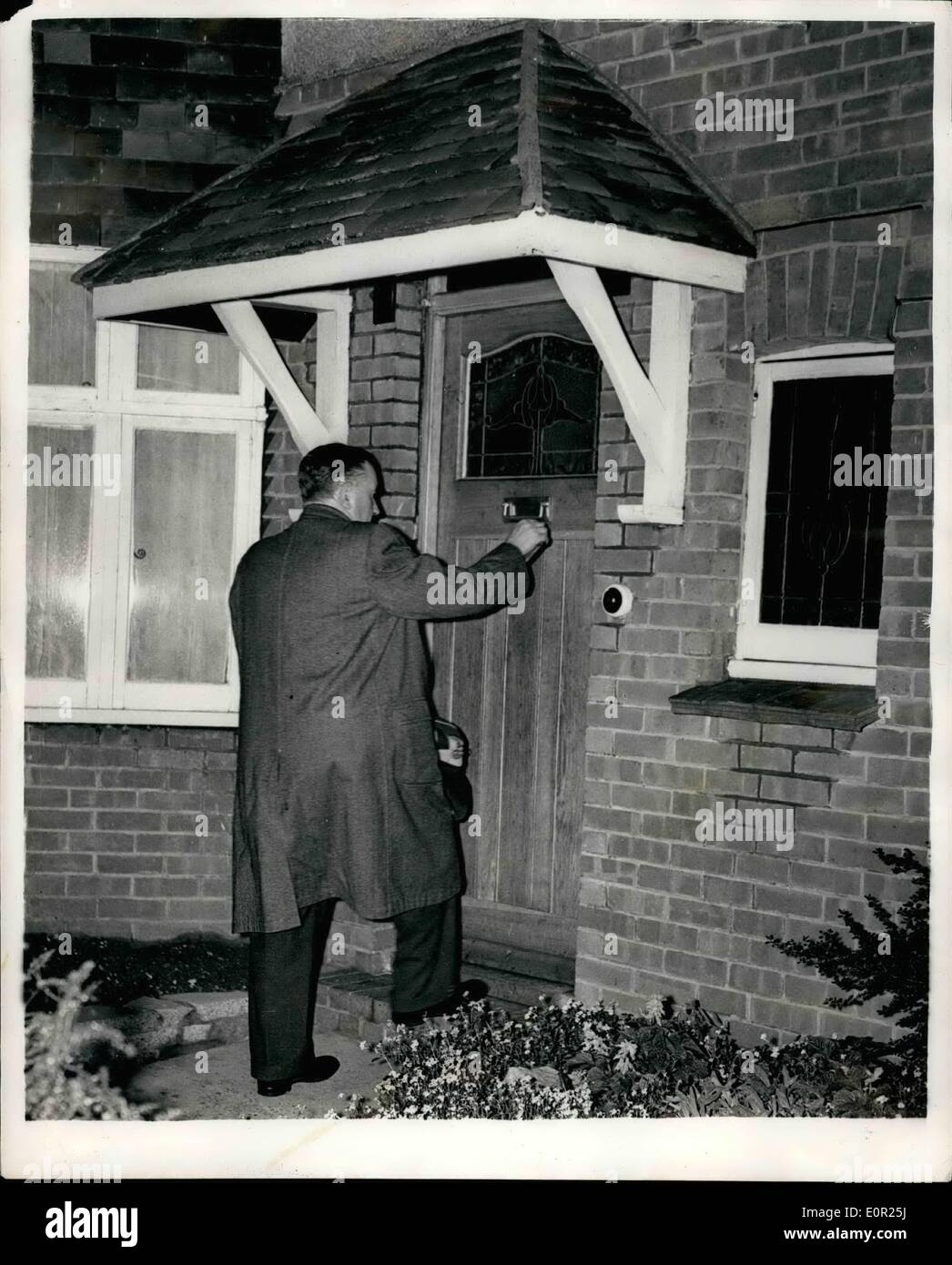 Oct. 10, 1957 - Brighton Police Chief Is Granted Bail But He Must Remain In His Home: Charles Ridge, suspended Chief Constable of Brighton, left a cell in Lowes jail yesterday to become a prisoner in his own home, He was bailed out by his daughter, Mrs. Betty Whiffen, 31-year-old children's officer. A few hours earlier an application for Mr. Ridge's release on 500 bail was granted by Mr. Justine Diplock, sitting in the Chambers in the High Court. The judge made three conditions; (1) Mr. Ridge must go straight home with his solicitor, Mr - Stock Image
