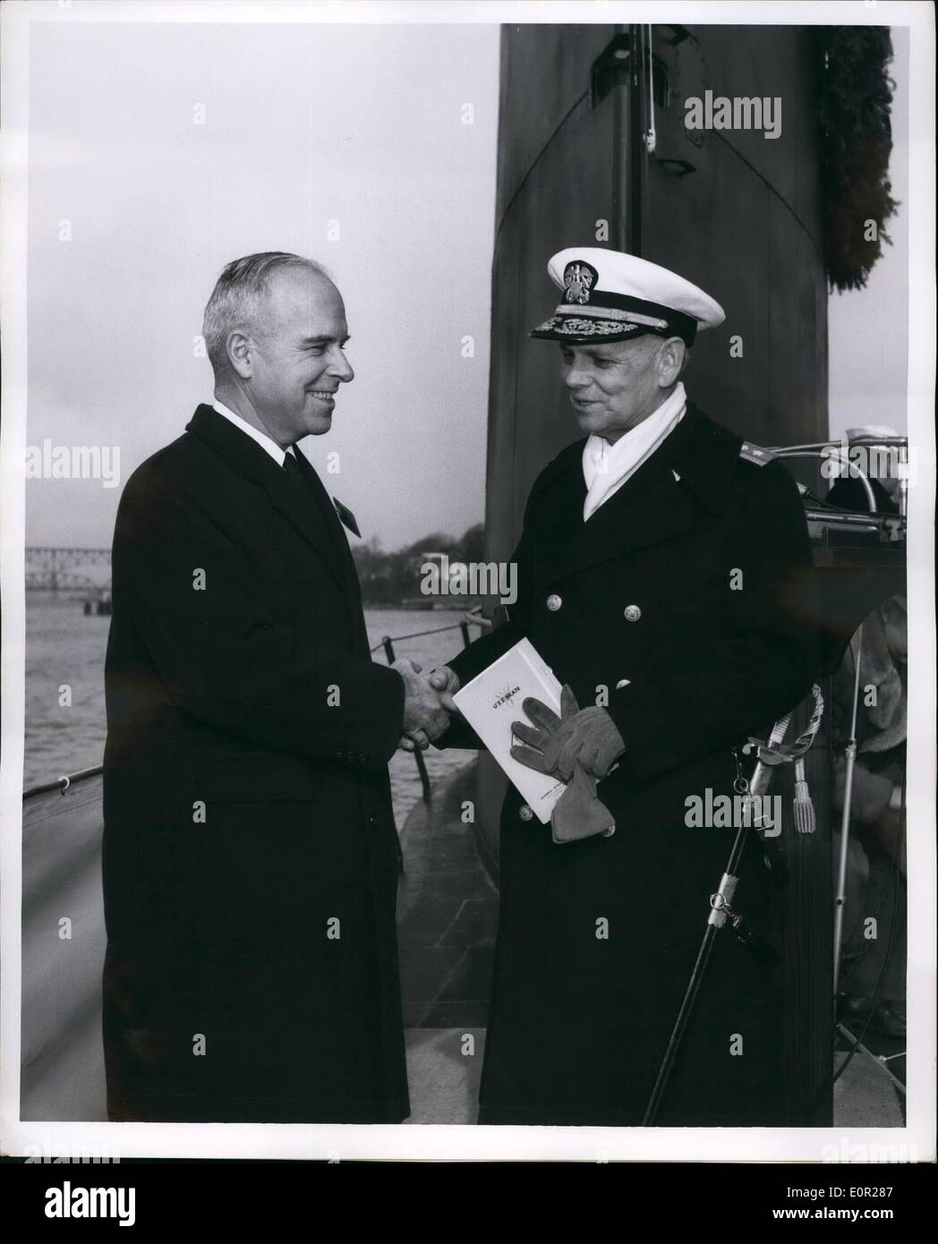 Dec. 12, 1957 - The Navy Certificate of Merit, for ''significant achievement'' in connection with the design and construction of the USS Nautilus, world's first atomic powered submarine, was presented to General Dynamic's Corporation's Electric Boat Division at Groton, Conn. Rear Admiral Milton E. Miles, Commandant, Third Naval District, makes the first presentation of the award to Carleton Shugg, Dynamics senior vice president. Award was given at commissioning of third A-sub Skate, seven months ahead of schedule. - Stock Image