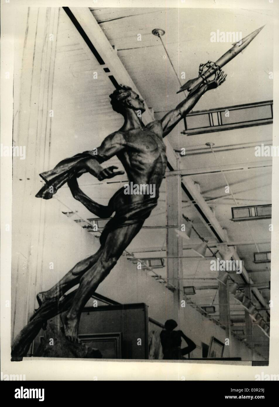 Dec. 12, 1957 - Modern art Soviet Version; ''To the stars'' is the name given to this piece of Sculpture by Russian artist G. Postinikow and it created plenty of interest at the ''All Union Art Exhibition held recently in Moscow. The figure illustrates the achievements of the country. with the outstreched arm holding a world encircling rocket. - Stock Image