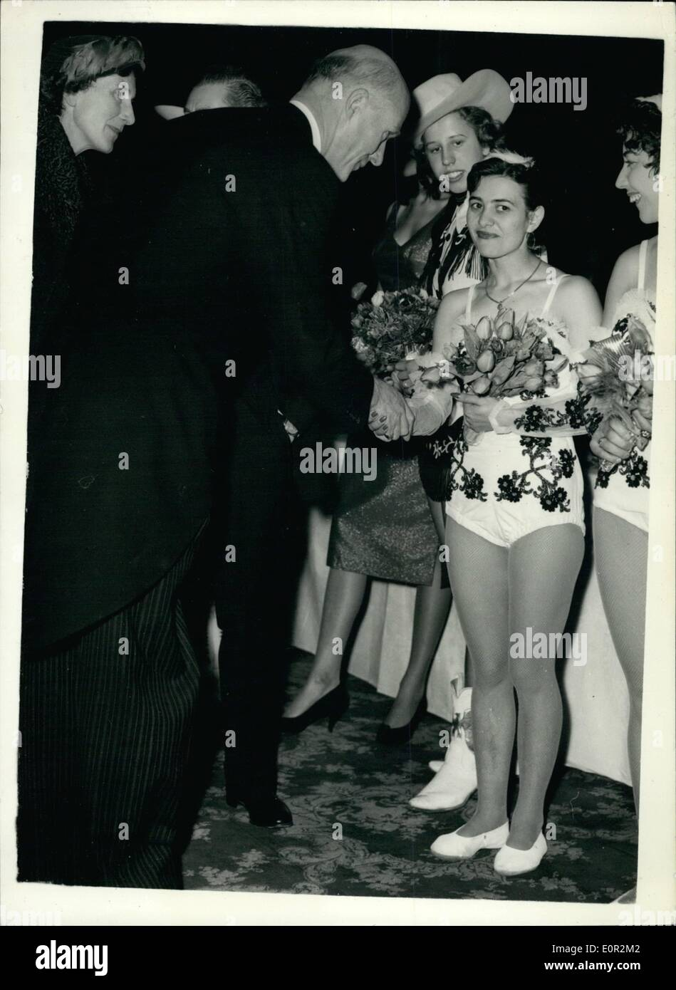Dec. 12, 1957 - The Lord Mayor Meets Circus Artistes. The Lord Mayor of London, Sir Denis. Truscott, chatting to a small trapese artist - at Olympia where the Bartra Hills Circus opens today - Stock Image