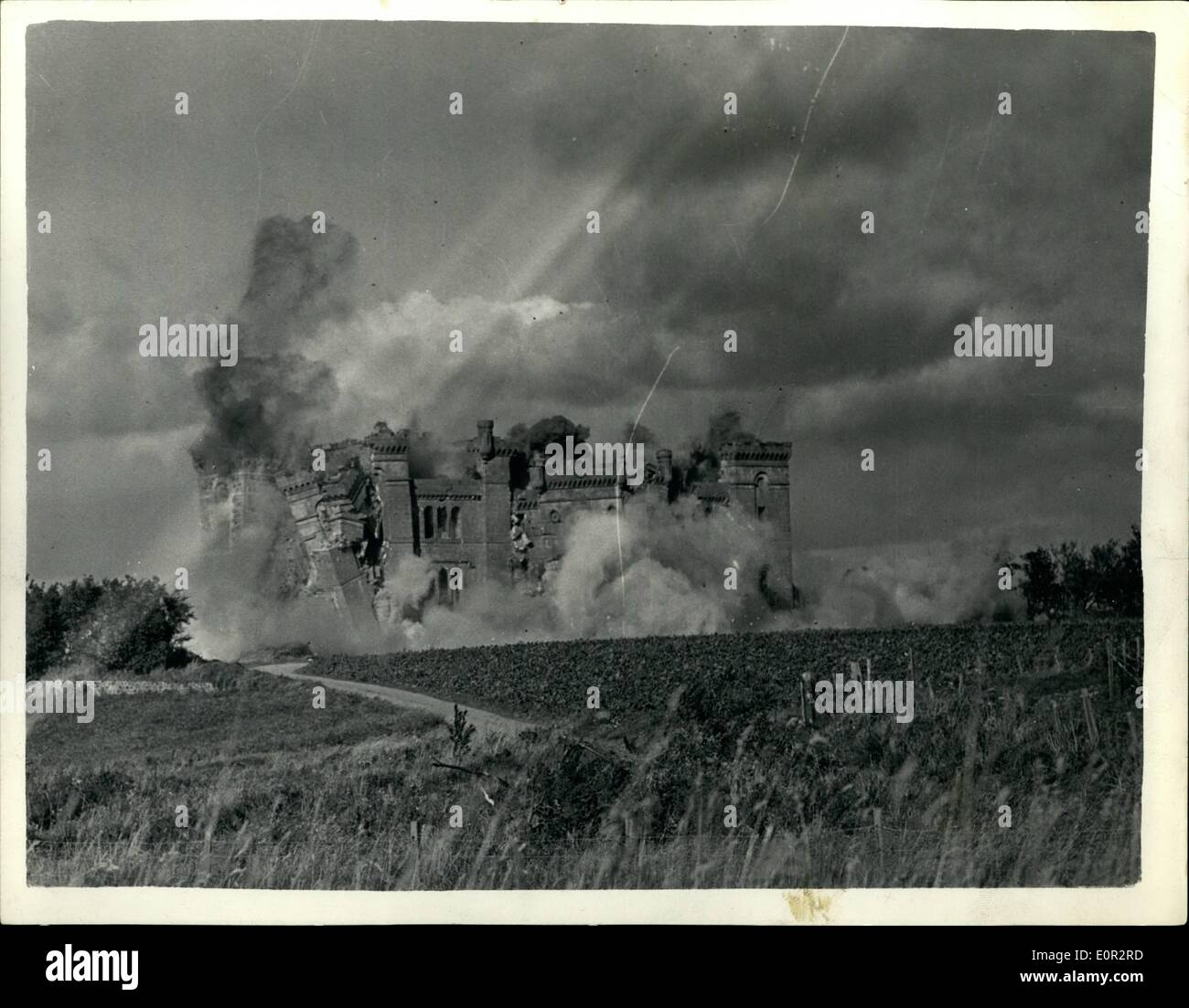 Oct. 10, 1957 - Ancient castle goes up in smoke. Blown up by 500 LBS. of explosives: The 150 year old Rossie Castle, near Montross was recently demolished by80 officer's and men of the 117 Field Engineering Regiment - with the aid of 500 lb. of plastic explosive. Within 30 seconds the castle - which was sold to a professional footballer 20 years ago for £1 - was reduced to 20,000 tons of rubble which will be used by the local council for road widening.. For weeks the Army engineers had been boring holes in the 3ft. 6in - Stock Image