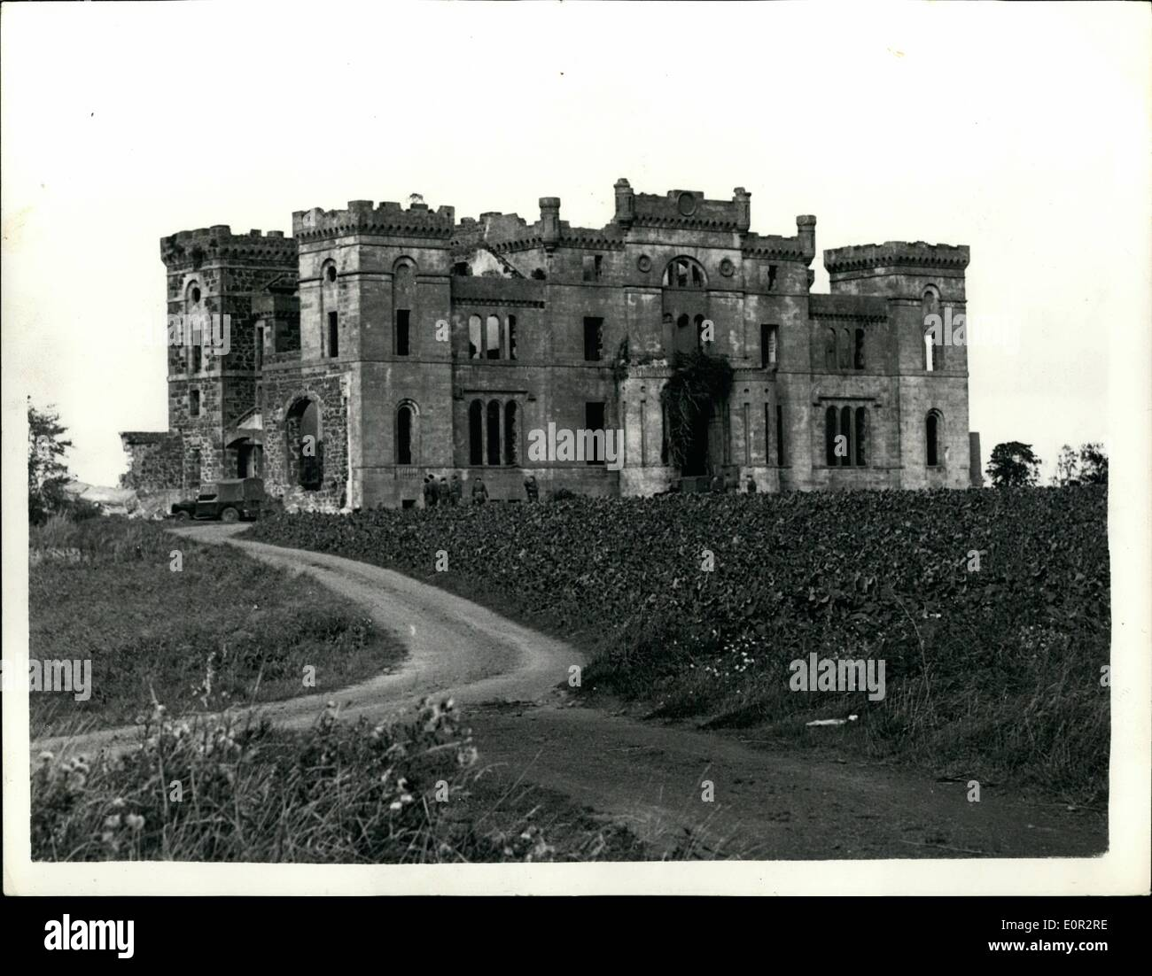 Oct. 10, 1957 - Ancient castle goes up in smoke. Blown up by 500 LBS. of explosives: The 150 year old Rossie Castle, near Montross was recently demolished by Army Engineers - with the aid of 500 lb. of plastic explosive. Within 30 seconds the castle - which was sold to a professional footballer 20 years ago for £1 - was reduced to 20,000 tons of rubble which will be used by the local council for road widening scheme.. For weeks 80 officers and men of 117 Field Engineering Regiment had been boring holes in the 3ft. 6in. thick walls - Stock Image