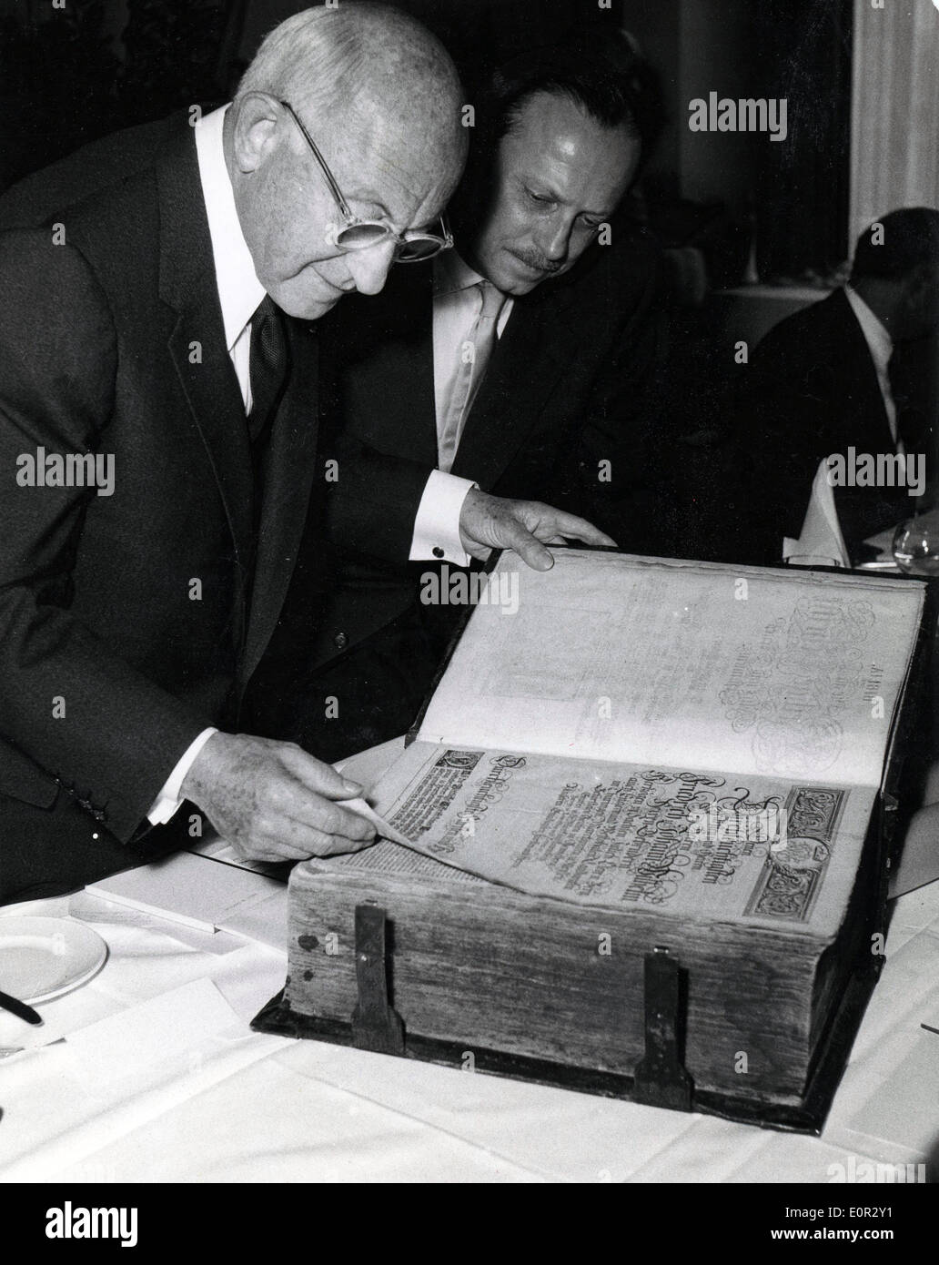 Oct 24, 1957 - Berlin, Germany - CECIL DEMILLE is presented with the Electoral Bible of 1798 by H. SCHAEFER during Stock Photo