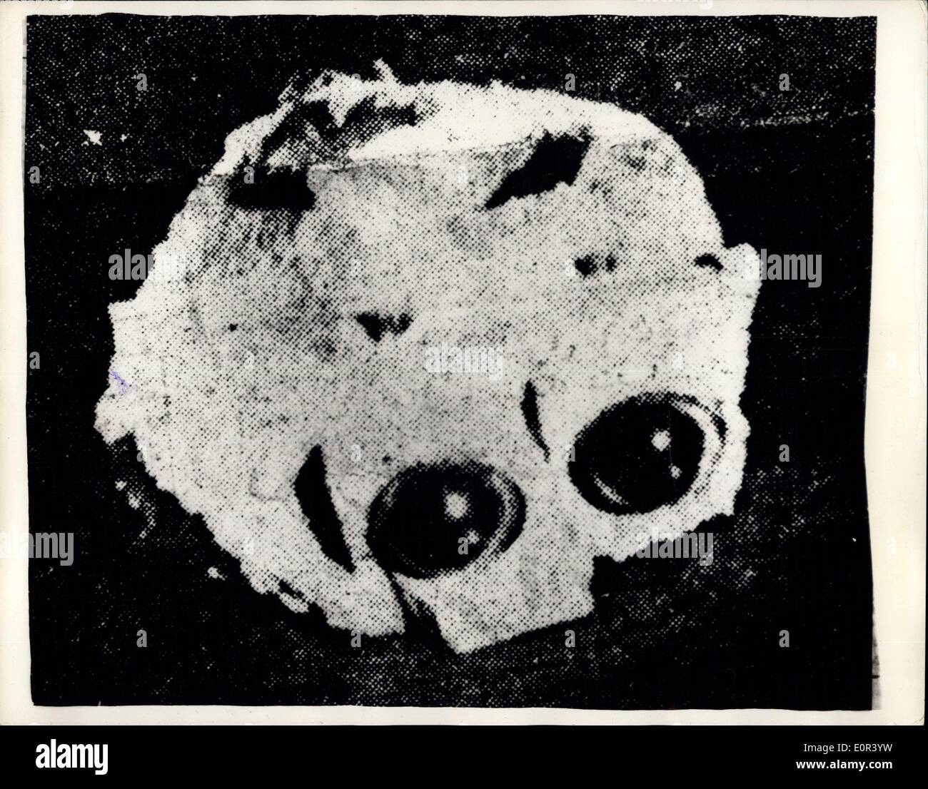 Nov. 12, 1957 - Mysterious Object Falls From The Skies Into An Alexandria School Yard: A small mysterious flaming object fell from the skies - and landed in the playground of the Salah eldin primary school, at Moharren Bay, Alexandria a few days ago. The object was i the form of a piece of white rubber with two lenses installed in one side-and a hole on the other side-pluse another hole and a lens on the other side. On each of the lenses there was apiece of copper wire - Stock Image