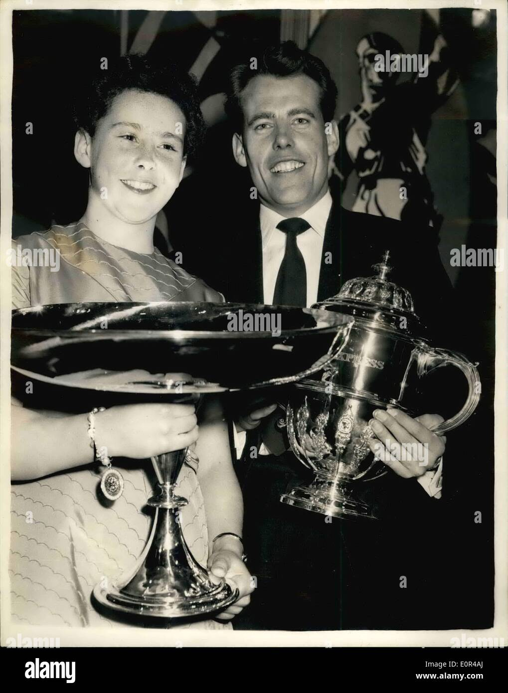 Dec. 12, 1957 - 12-12-57 The Sportsman and Sportswoman of the Year. George Derek Ibbotson, Britain's famous runner, was elected Sportsman of the Year when he swept into first place in a record ballot of votes. Diana Wilkinson, the 13-year old swimmer of Stockport, Cheshire, was elected Sportswoman of the Year . The youngest ever lassie to win this national accolade. Last night millions of TV viewers saw the presentation of the trophies at Grosvenor House - Stock Image