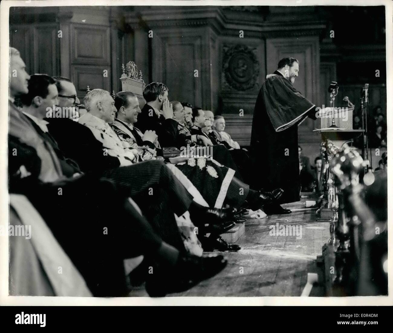 Feb. 02, 1958 - The Duke of Edinburgh faces a barrage of toilet paper at Edinburgh University:The Duke of Edinburgh was hit by a flying roll of toilet paper at Edinburgh University yesterday.  gr as the end of the roll lanced in his lap. He put on his mortar board to prevent further direct its. wearing is robes as a cancellor, he was sitting on the platforn watching actor James Robertson Justice being installed as the university's recor. The Duke had one of the rowdiast receptions given by students on Rectorial Day for years - Stock Image