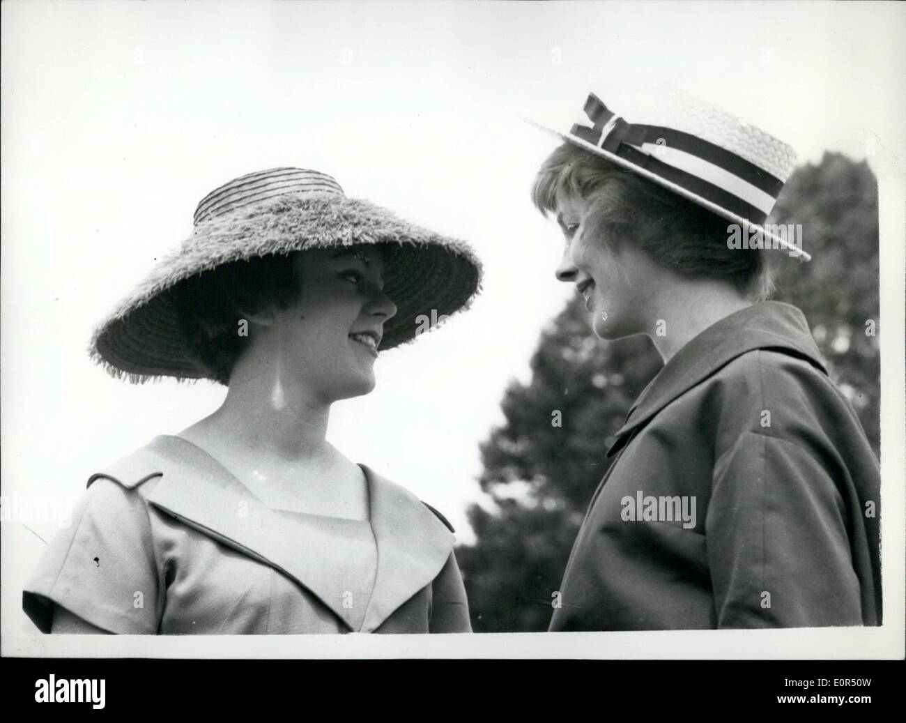 Mar. 03, 1958 - It's Boater Day at Henley. Keystone Photo Shows: Martina Foster, wearing a Royal Blue Italian straw hat, and Anne Clarke, wearing her boy friend's straw boater - at Henley today, where it appears to be a boater fashion day for the ladies - on the second day of the famous regatta. - Stock Image
