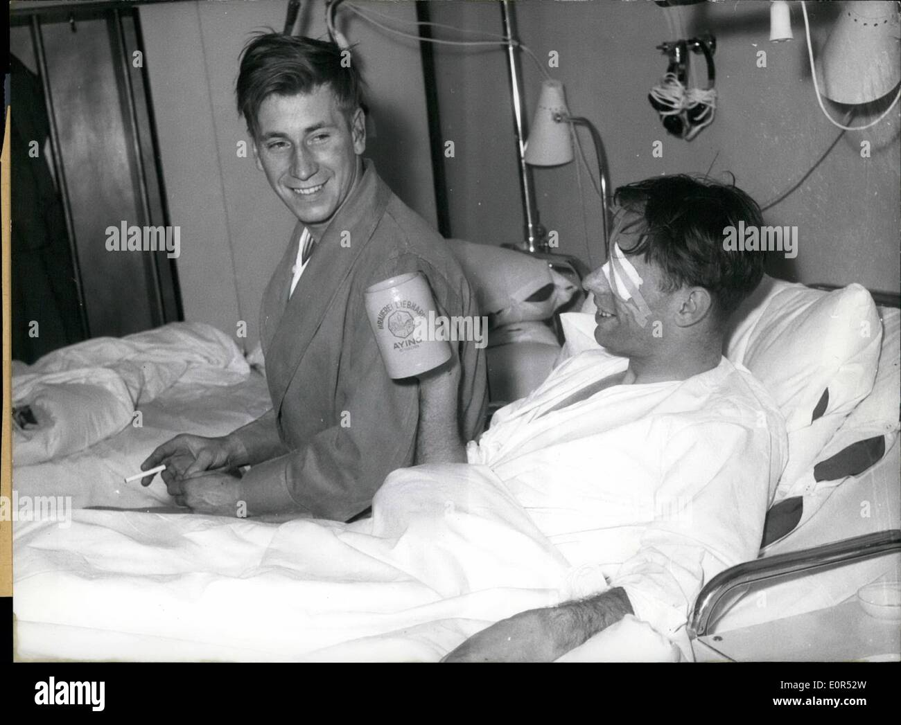 Feb. 02, 1958 - In the hospital at the right side of the Isar in Munich several injured members of the foot ball team Manchester United, injured at the aircraft's catastrophe at February 7,58 in munches- rime, already are on the way of recovery. Picture 1, Kwan Morgan sitting in a wheel chair on the way to the X-rays. Picture 2, Bobby Charlton already is drinking out of a genuine Bavarian beer - tankard. picture 3 , wood Raymond (left side) and Bobby Charlton(right side) already are able to laughs - Stock Image