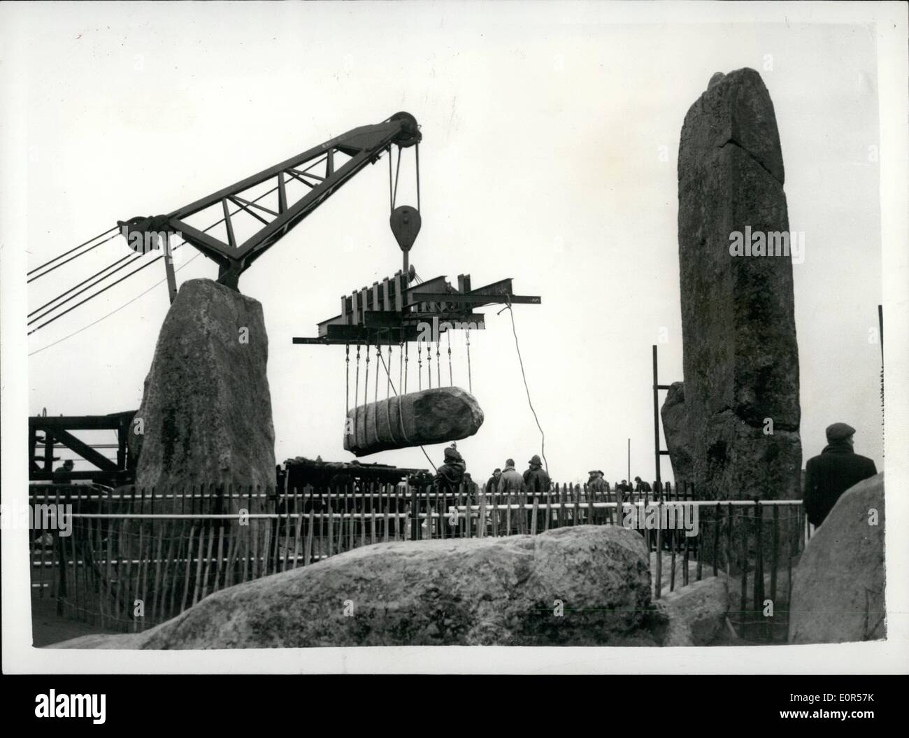 Mar. 03, 1958 - Restoration of Stonehenge continues. Lifting sixteen ton Lintel.: Work is continuing on the restoration of Stonehenge - by the Ministry of works at a cost of ?8,500. A sixty ton crane was in use today lifting the 16 ton lintel of the fallen trilithon. The two huge uprights and the lintel have lain untouched since the end of the 18th century when amateur excavators caused their downfall. In addition - three stones of the outer circle are being replaced as many of the stones that were believed to have been knocked down by the Romans are being left as they were - Stock Image