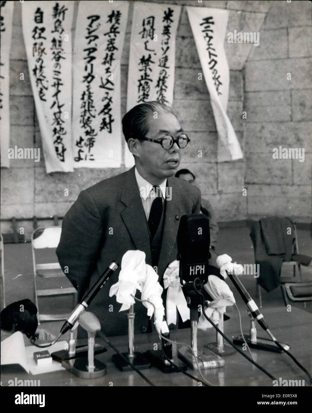 Apr. 04, 1958 - Anti Nuclear Rally in Tokyo. A mass rally attended by more than 6,000 members of the general council of Japan Trade Unions, Japan against Atomic and Hydrogen bombs, National federation of student self - government associations and other affiliated organisations , was held at Hibiya Park, Tokyo, in protest against the use of Japan as a nuclear base. The rally approved a resolution against nuclear weapons which will be delivered to the governments of the U.S - Stock Image