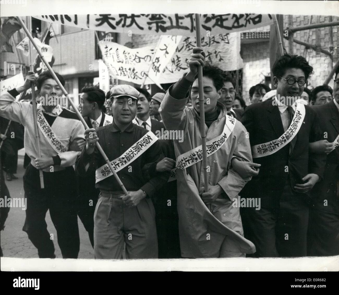 Apr. 04, 1958 - Anti Nuclear Rally in Tokyo. A Mass rally attended by more than 6,000 members of the General Council of Japan Trade Unions, Japan Against Atomic and Hydrogen Bombs, National Federation of Student Self Government Associations and other affiliated organisations, was held at Hibiya Park, Tokyo, in protest against the use of Japan as a nuclear base. The rally approved a resolution against nuclear weapon which will be delivered to the governments of the U.S., Britain and the Soviet Union - Stock Image