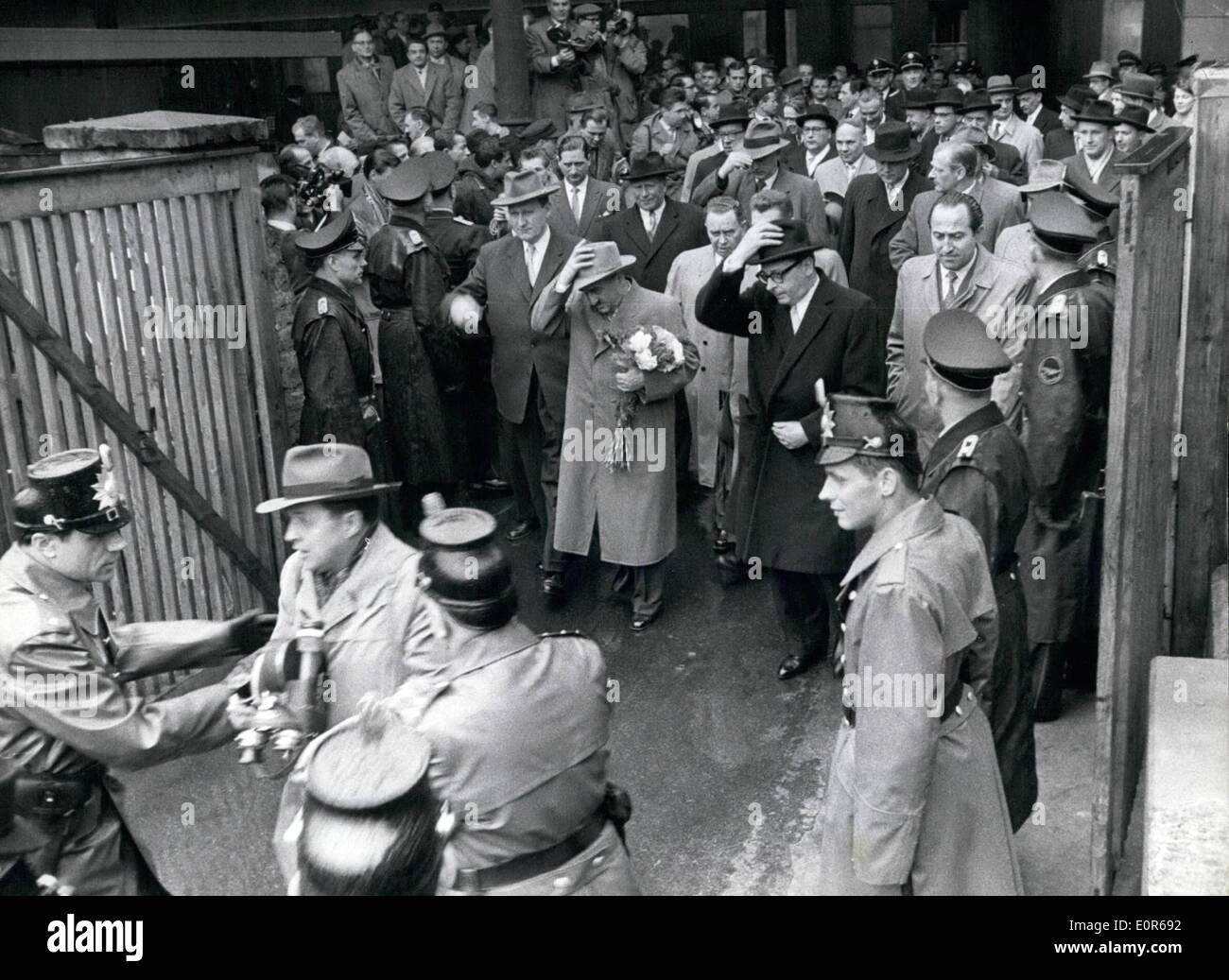 Apr. 04, 1958 - Tumult at Mikoyan visit at the Bonn station : The Soviet guests with Anastas Mikoyan were arriving at the Bonn central station, tumulteous incidents were occurring between the station police and some journalist. Out picture shows. A journalist led off by the police in front to of Mikoyen. In the background the Soviet ambassador Simrnow, anastas Mikojan and Foreign minister Heinrich Von Beentano. (From left to right side) - Stock Image