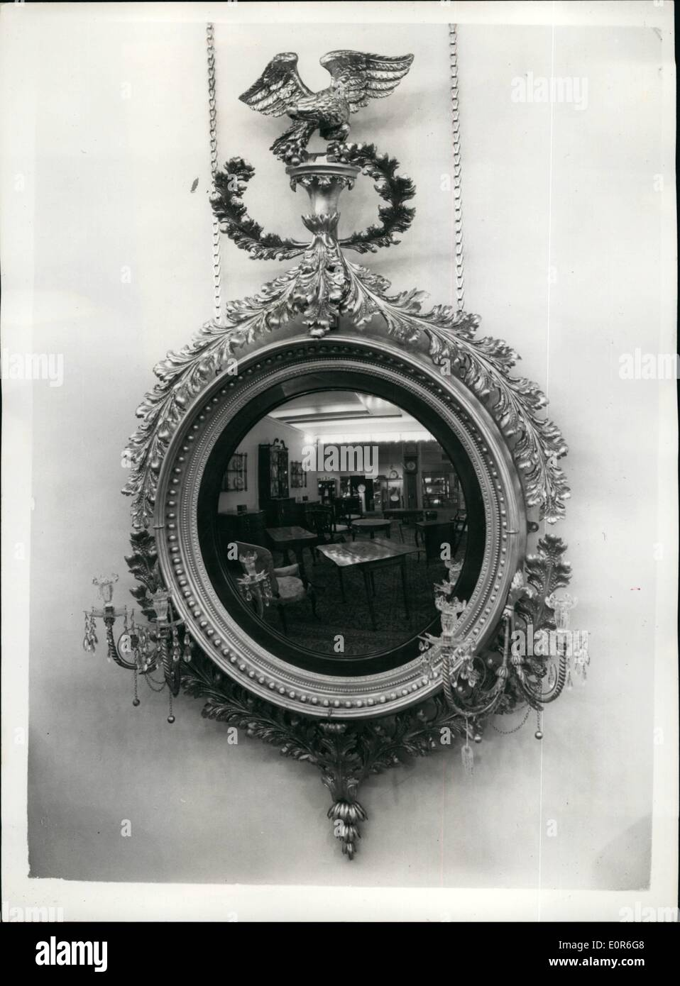 Jun. 06, 1958 - Press preview of the antique dealer's fair; A press preview was held today of the Antique Dealer's Fair and Exhibition, which will be opened by Princess Alexandra at Grosvenor House tomorrow. Photo Shows Some of the exhibits are seen reflected in this magnificent Convex Mirror, exhibited by M. Harris & Sons. - Stock Image