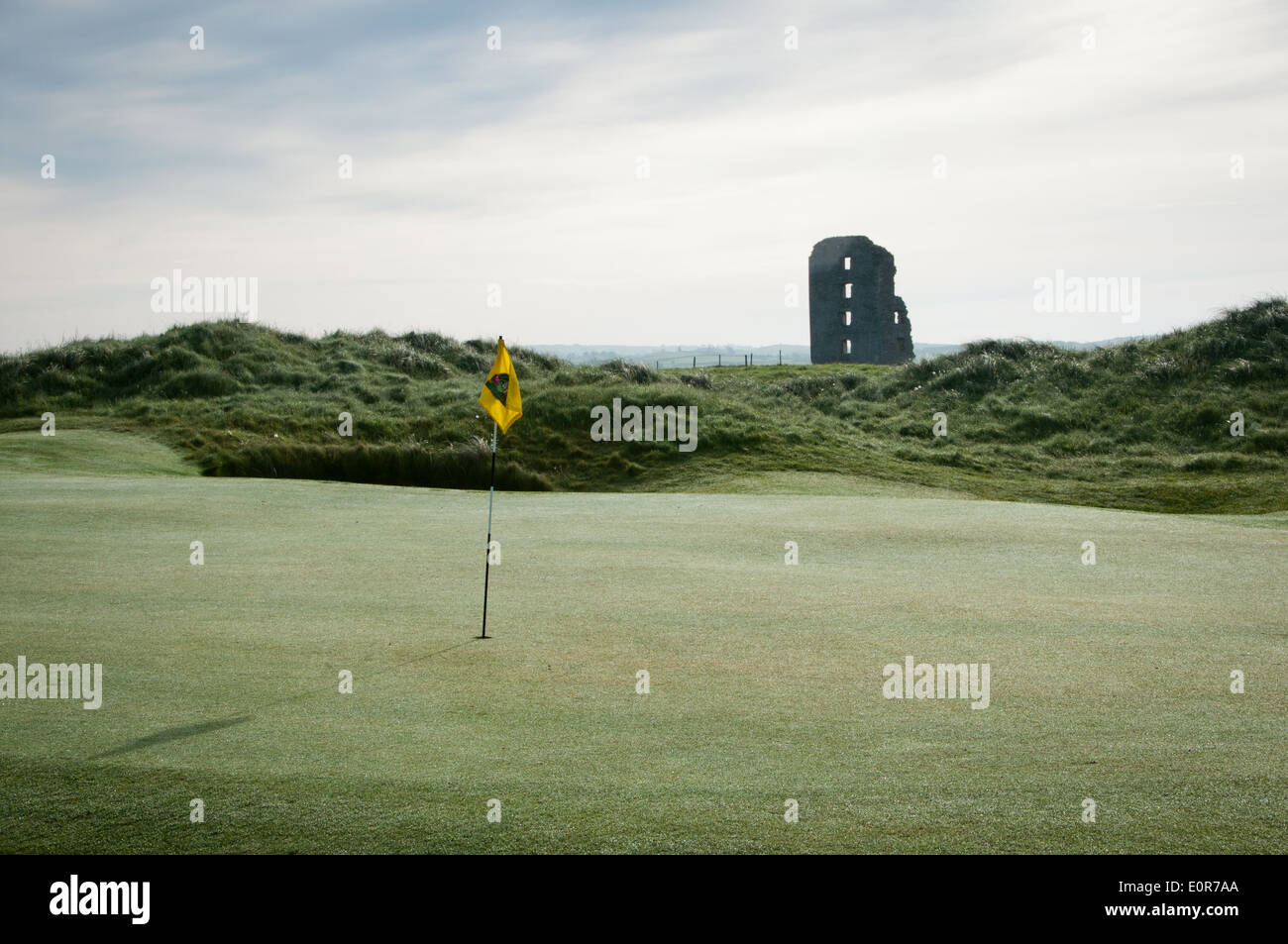 Putting Green with pin and castle in background - Stock Image