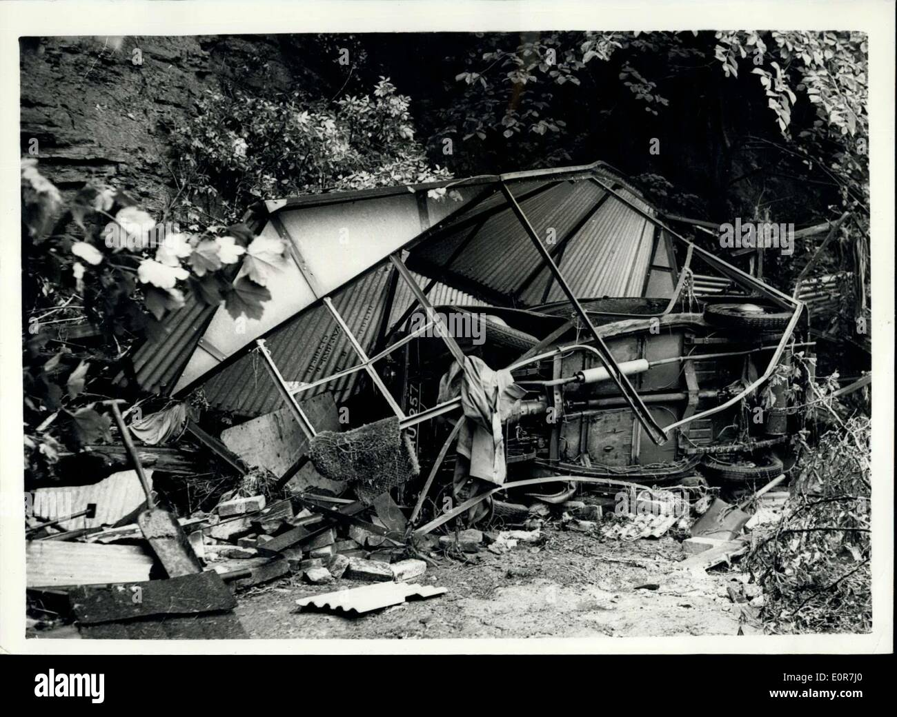 Jul. 04, 1958 - Car and Garage washed away in the sheffield floods: Photo Shows A Garage and car after it had been washed 200 yards from its mooring at Moscow cottages, Abbeydale, Sheffield during the heavy floods which covered vast areas following the heavy rains. - Stock Image