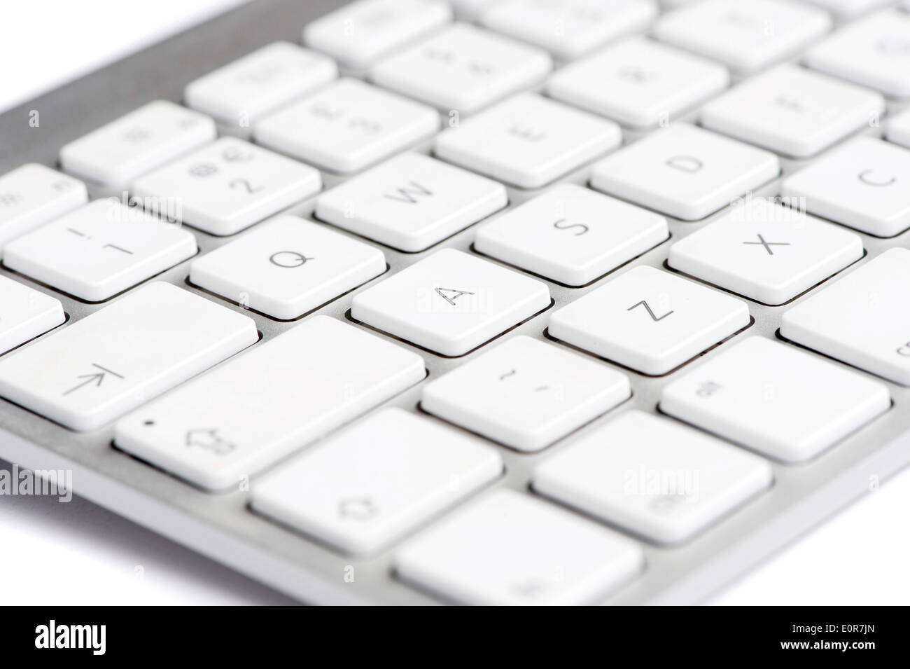 Apple mac white Keyboard focused on the letter A - Stock Image