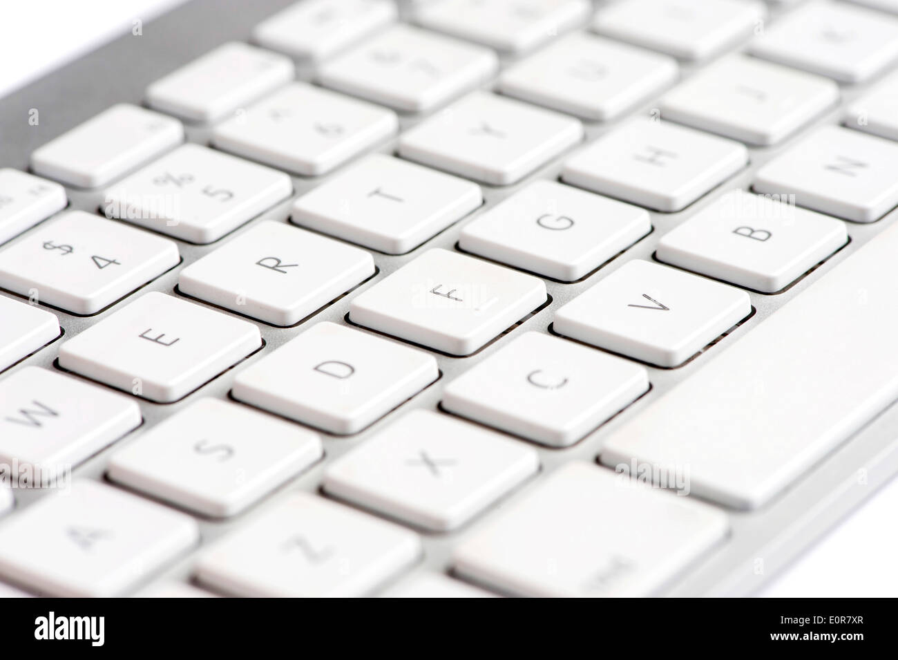 Apple mac white Keyboard focused on the letter F - Stock Image