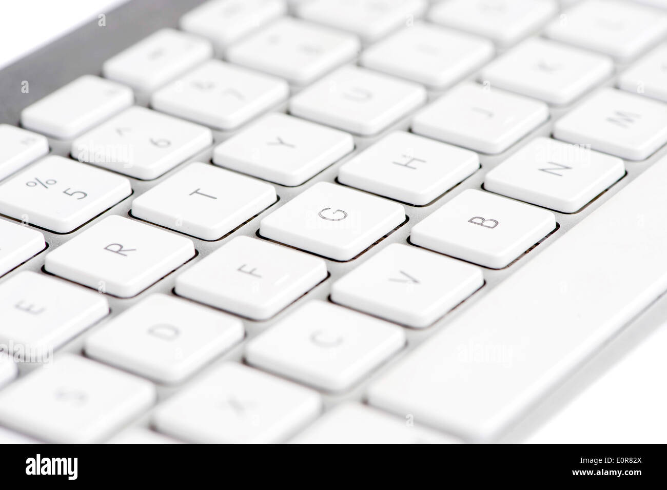 Apple mac white Keyboard focused on the letter G - Stock Image