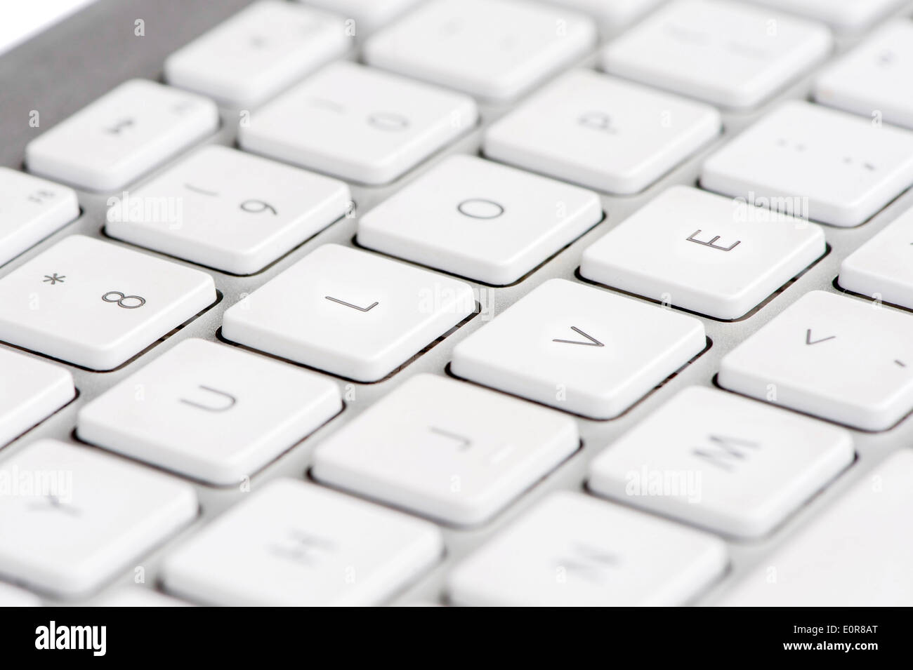 Apple mac white Keyboard spelling out the word LOVE - Stock Image