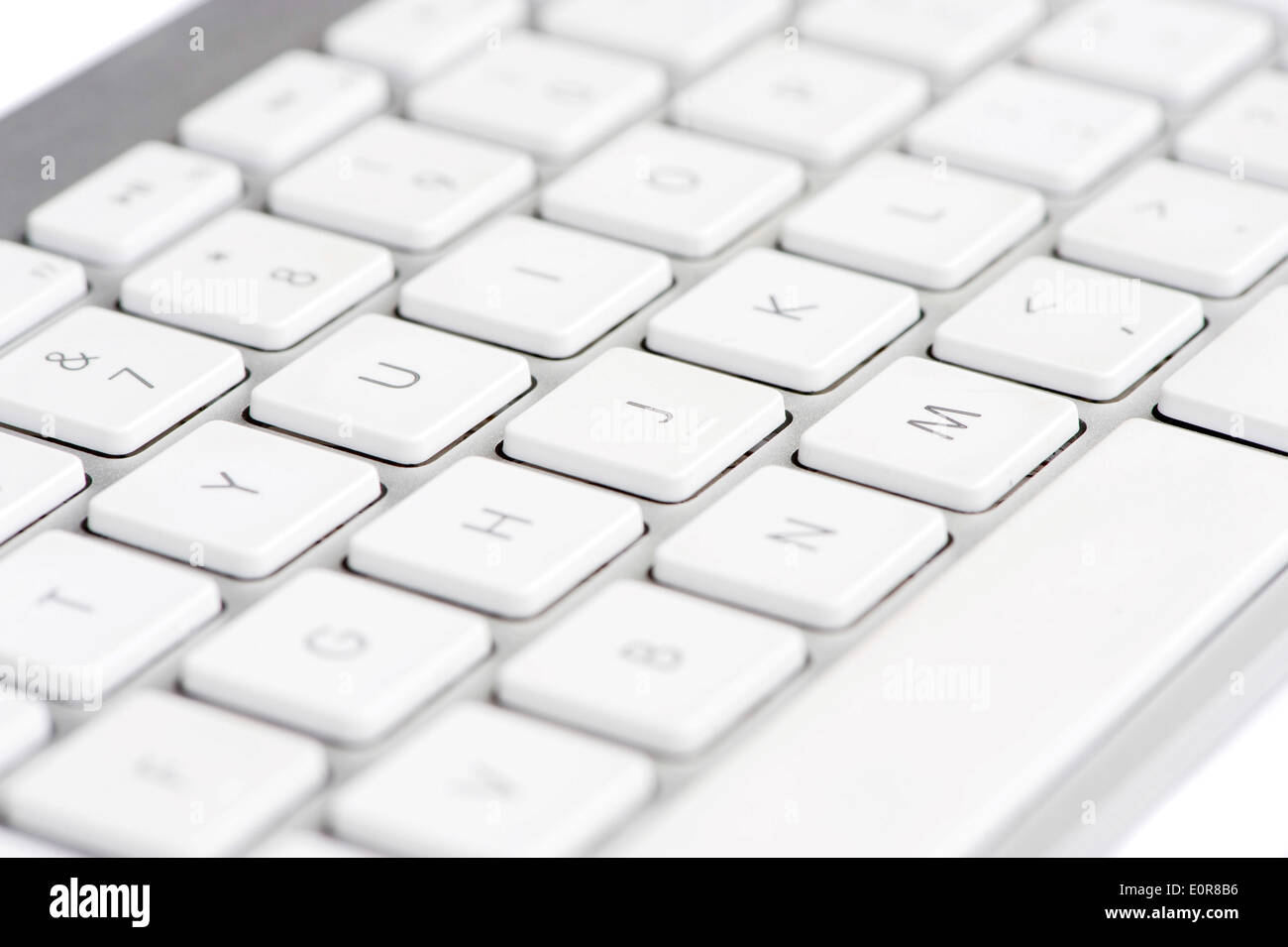 Apple mac white Keyboard focused on the letter J - Stock Image